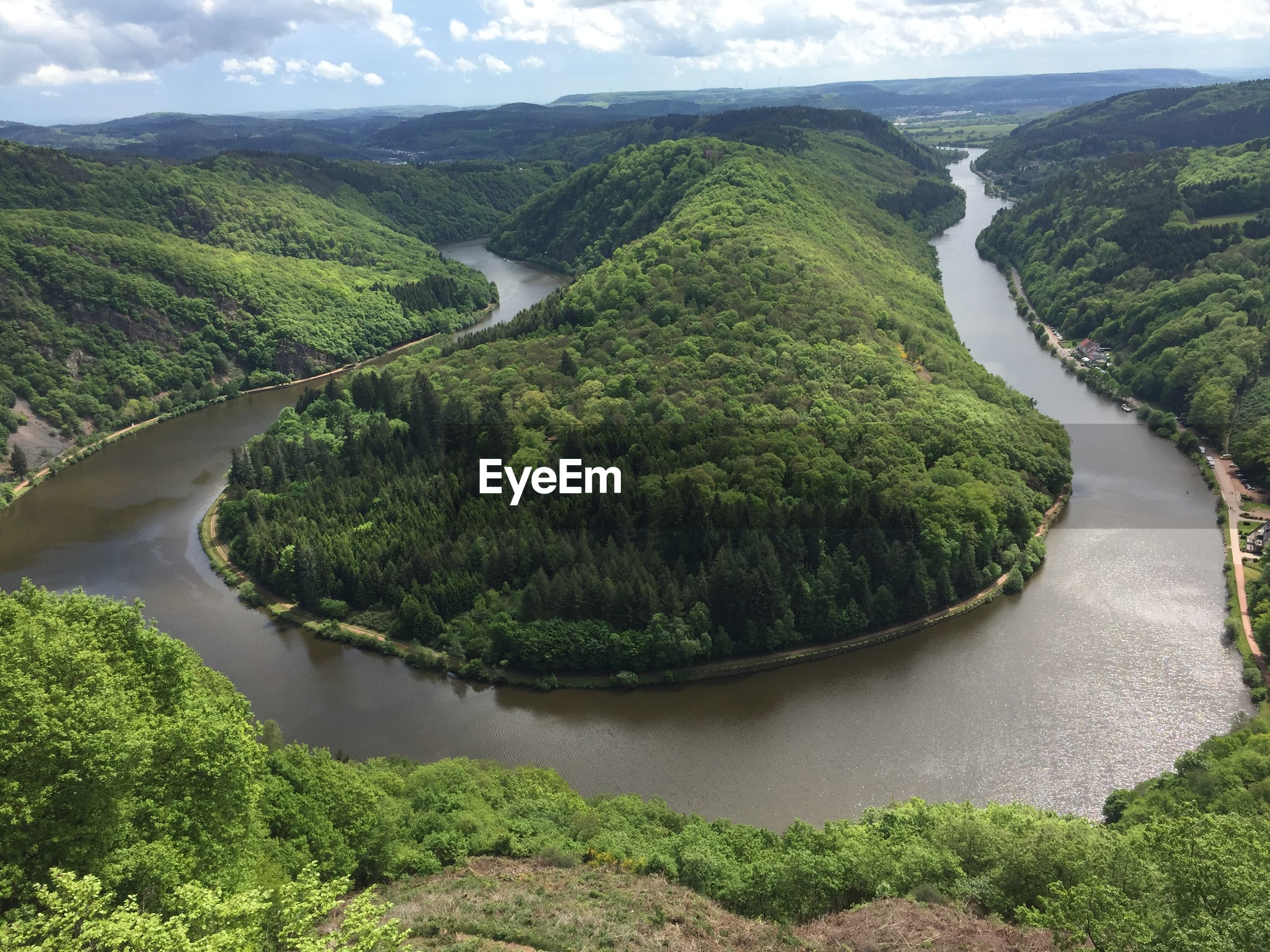 High angle view of river amidst green landscape