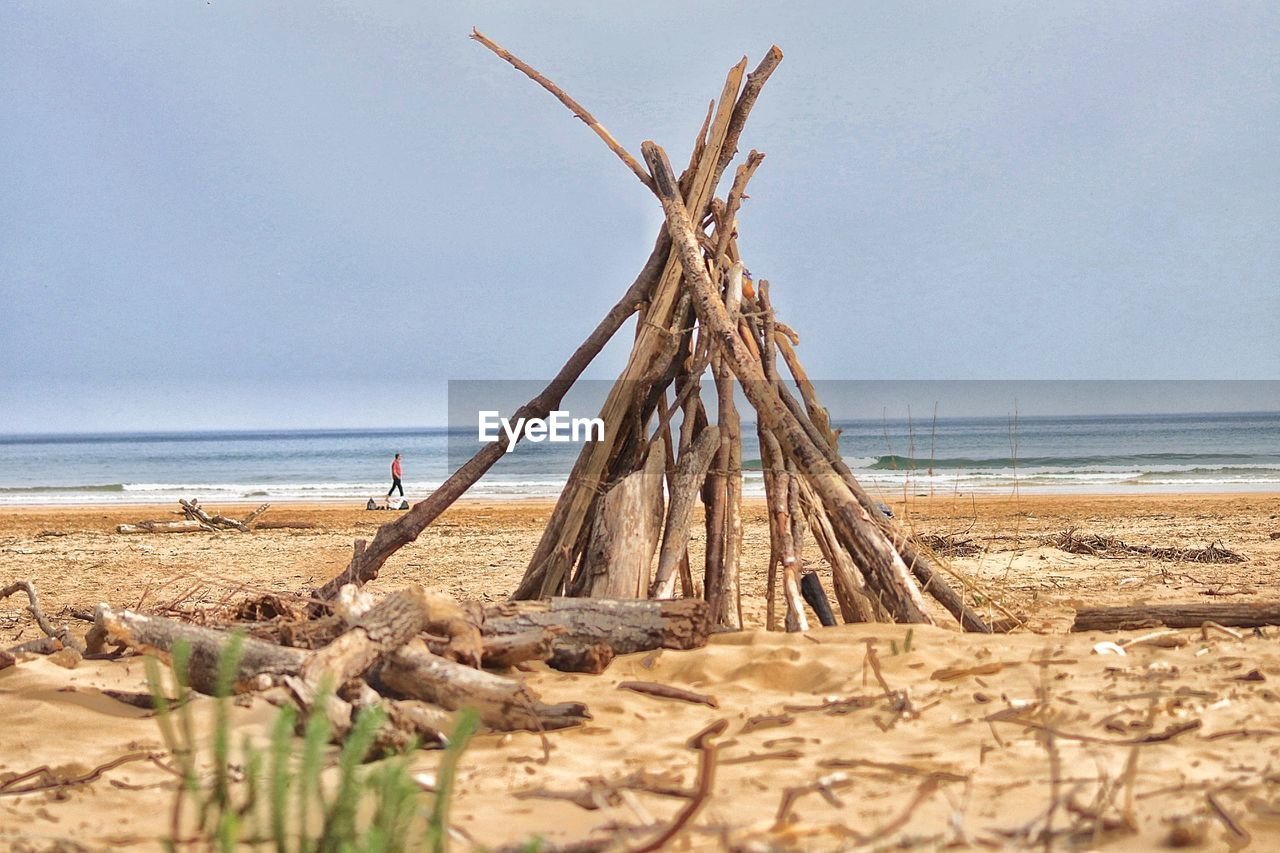 sea, land, water, sky, beach, horizon, tranquility, horizon over water, scenics - nature, tranquil scene, beauty in nature, sand, nature, day, no people, wood - material, wood, non-urban scene, idyllic, driftwood, outdoors, dead plant