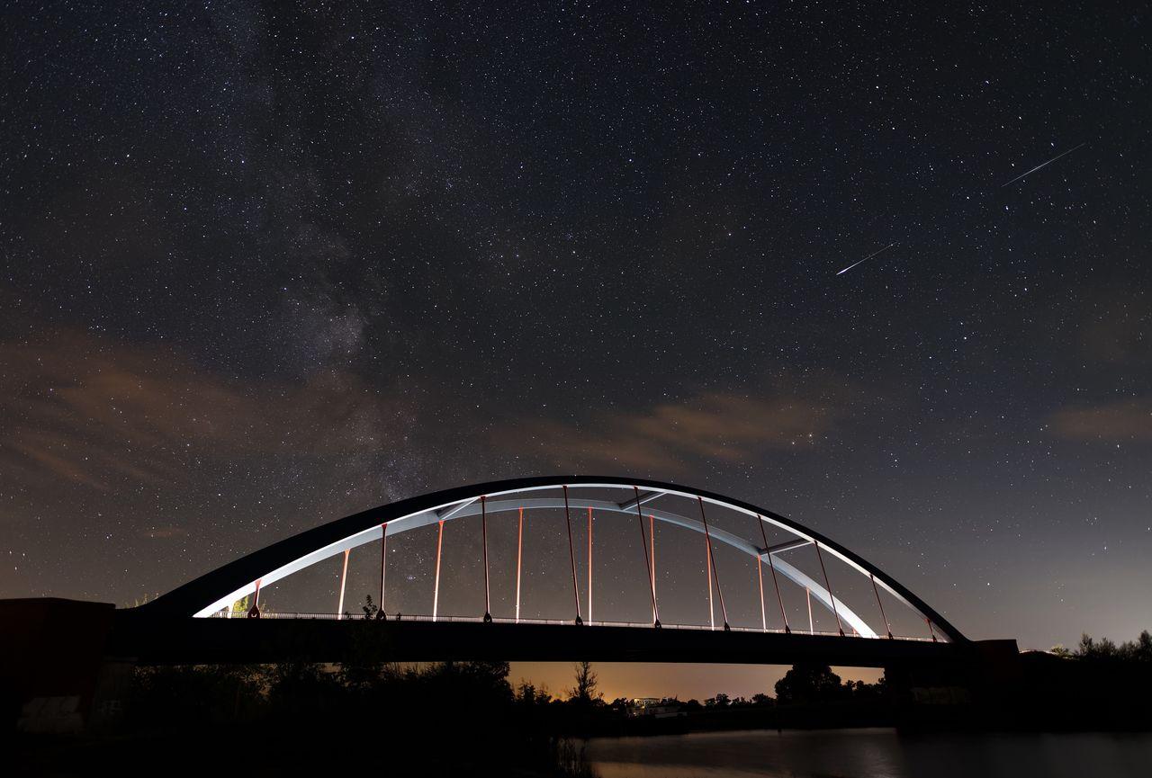 Silhouette Bridge Against Sky At Night