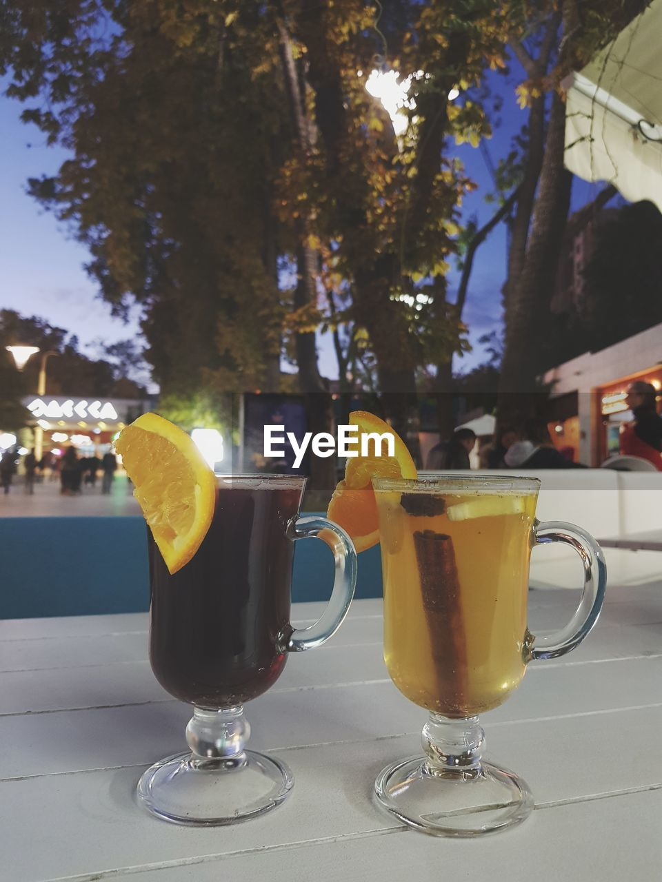food and drink, refreshment, drink, table, drinking glass, slice, yellow, freshness, tree, alcohol, close-up, cocktail, no people, outdoors, day, healthy eating, ready-to-eat
