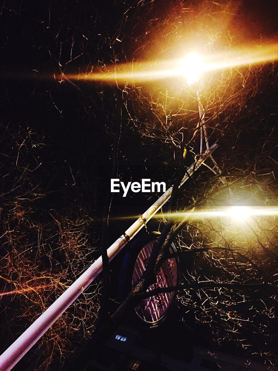 night, lens flare, illuminated, glowing, outdoors, no people, long exposure, light beam, nature, close-up
