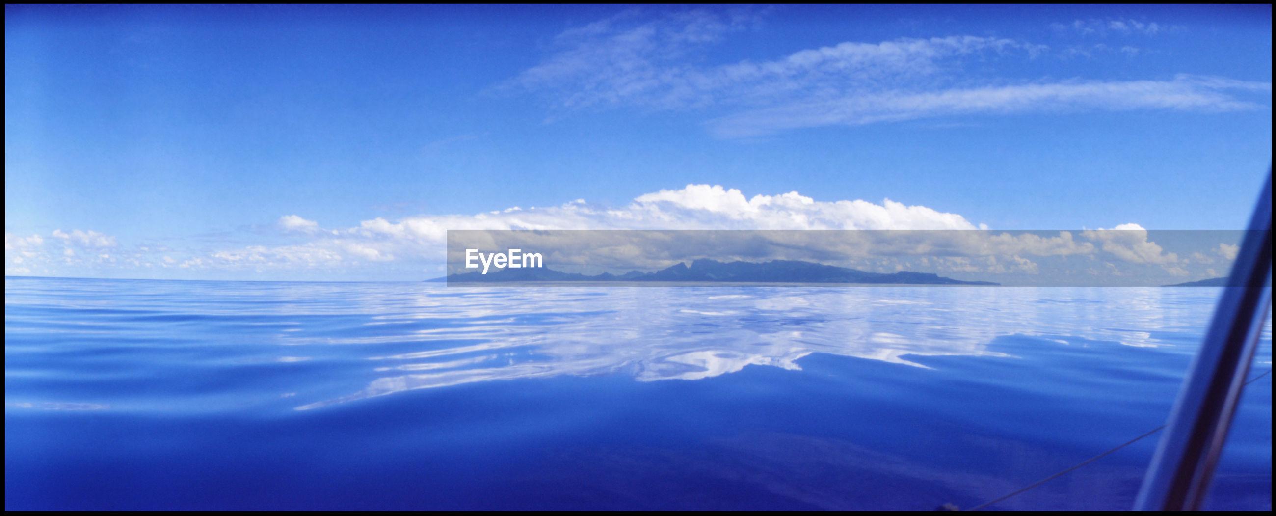 View of calm sea against blue sky