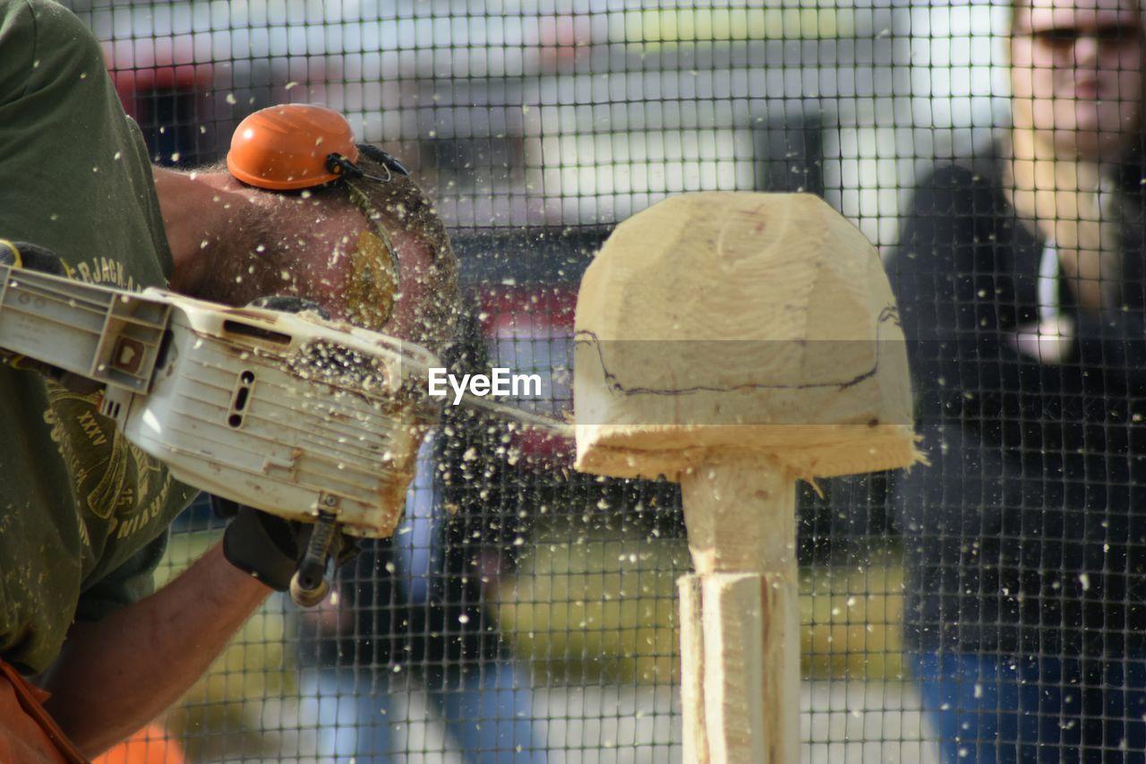 Artist carving wood