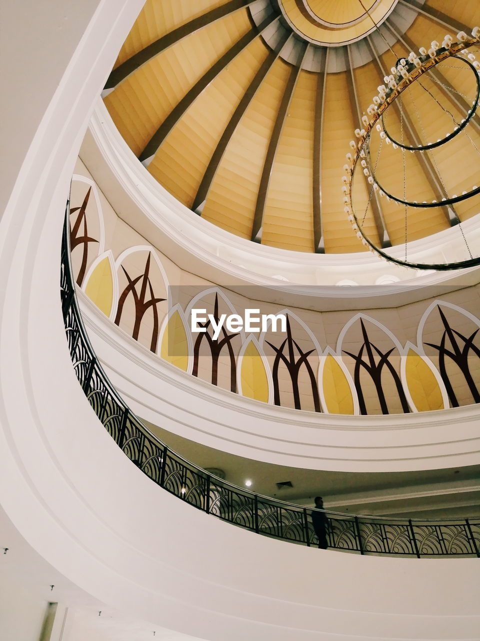 indoors, built structure, railing, architecture, pattern, spiral, steps and staircases, no people, staircase, low angle view, spiral staircase, design, close-up, ceiling, curve, decoration, white color, shape, architectural feature, ornate, directly below, luxury
