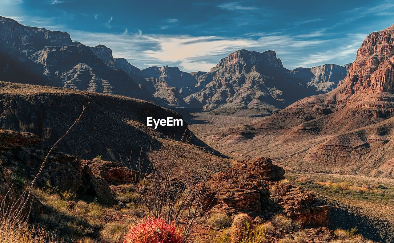 mountain, beauty in nature, scenics - nature, sky, tranquil scene, environment, tranquility, mountain range, landscape, non-urban scene, cloud - sky, nature, plant, no people, idyllic, remote, tree, day, physical geography, sunlight, outdoors, formation, mountain peak, arid climate