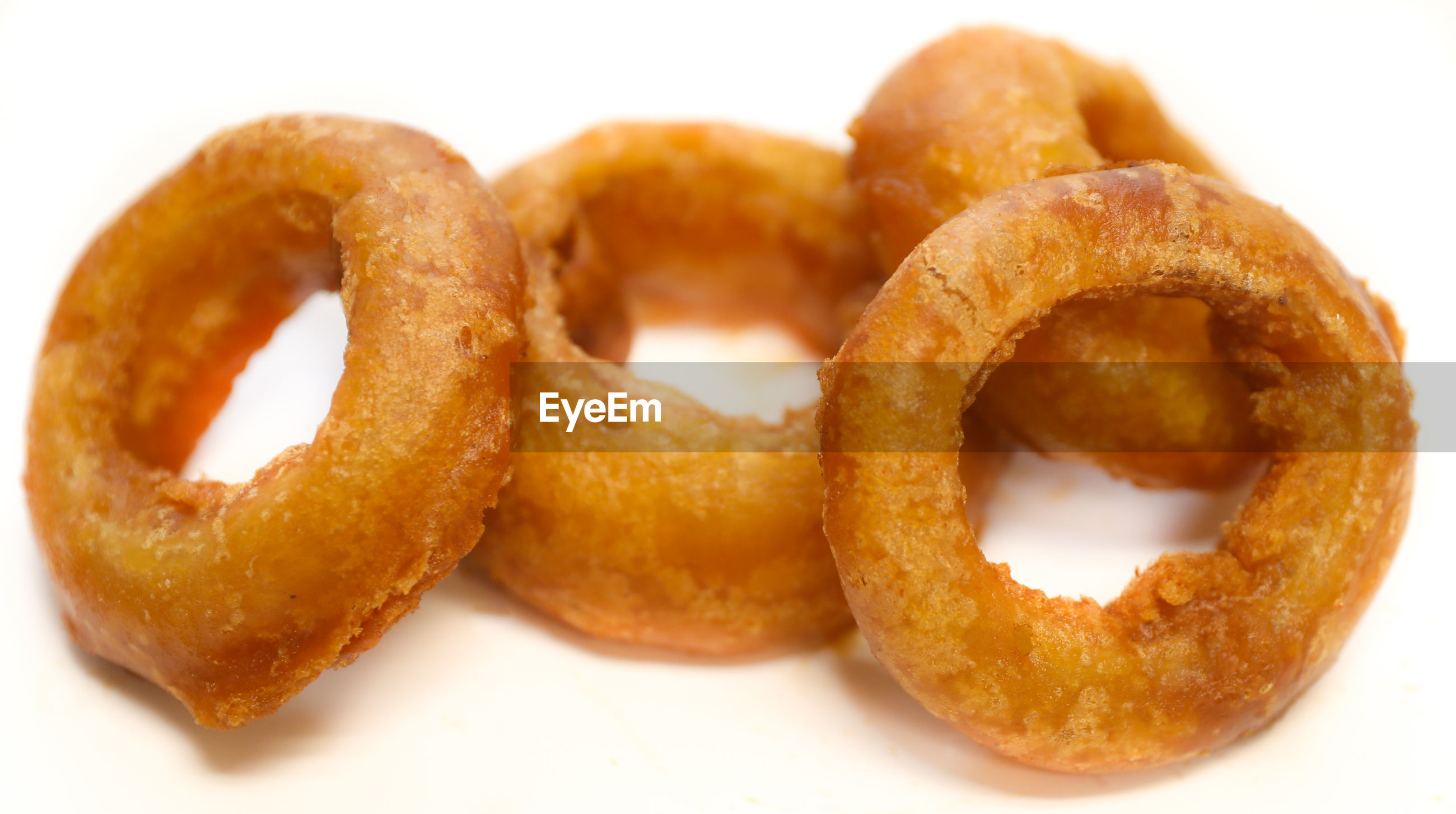 Close-up of onion rings against white background