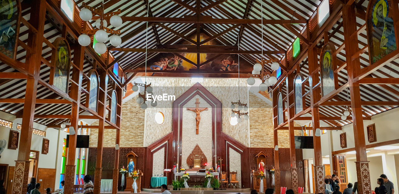 architecture, built structure, religion, place of worship, spirituality, belief, building, day, group of people, indoors, incidental people, travel destinations, representation, ceiling, altar, ornate