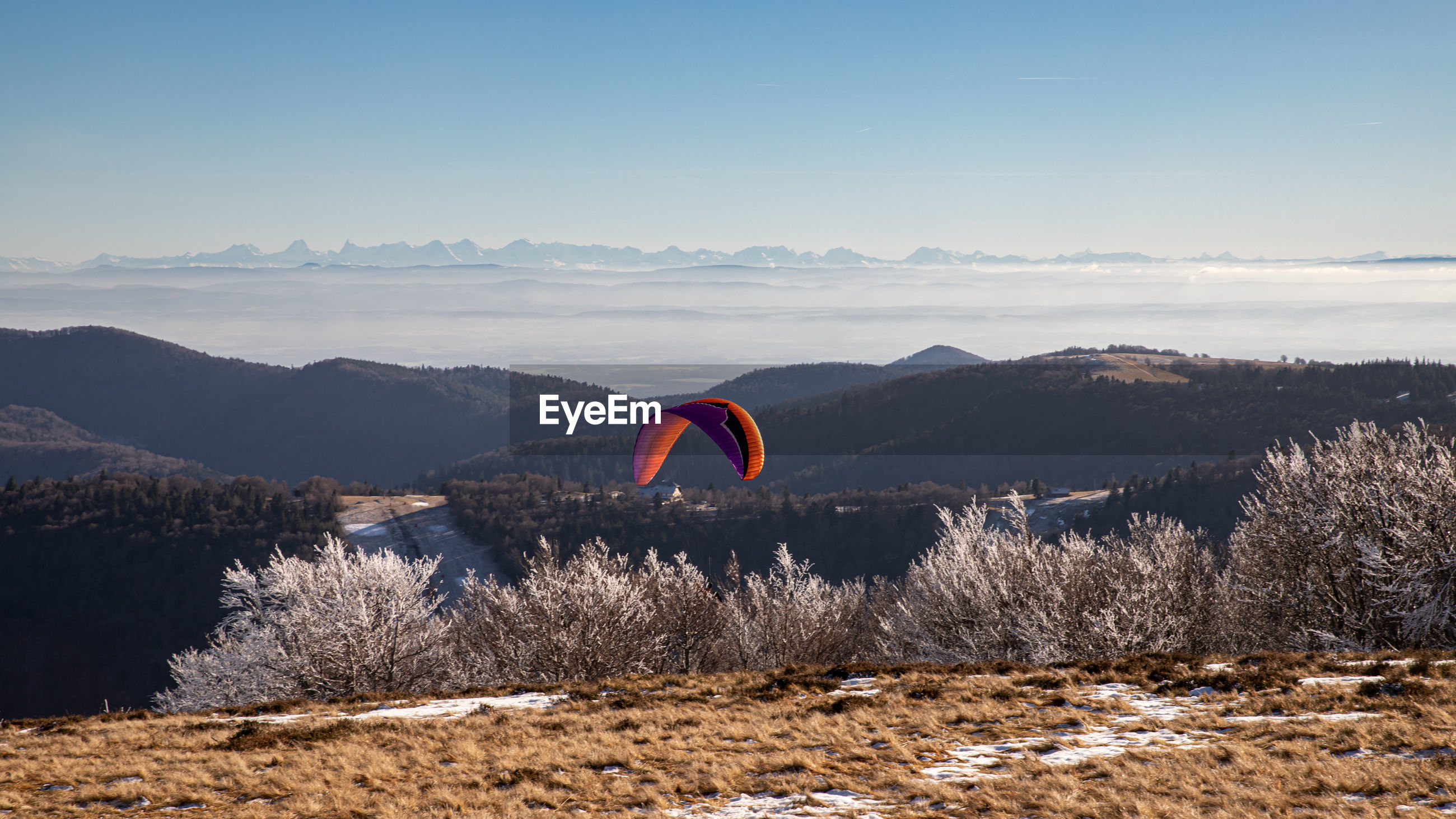HOT AIR BALLOON FLYING OVER LAND