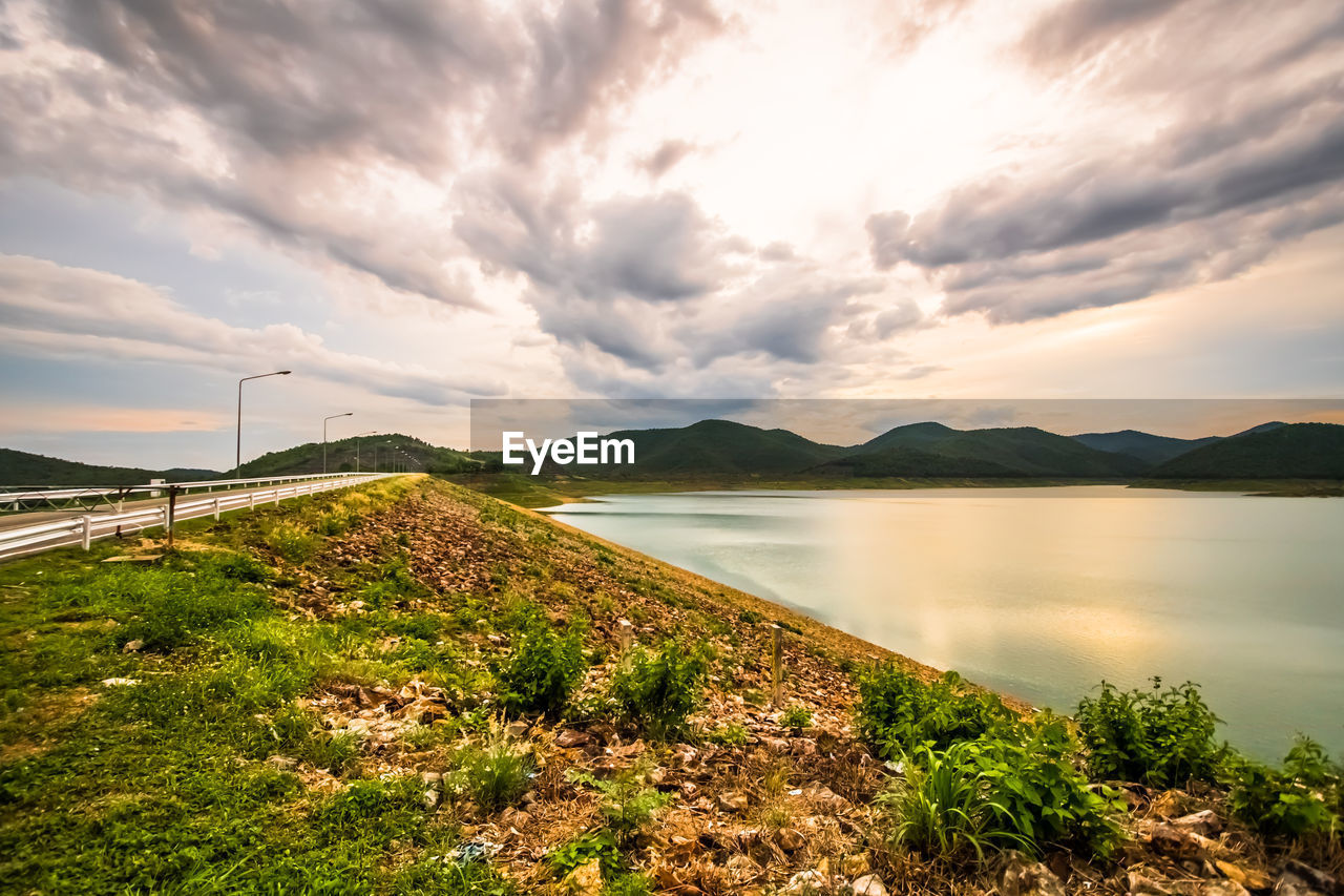 cloud - sky, sky, scenics - nature, water, beauty in nature, tranquil scene, tranquility, nature, no people, plant, lake, non-urban scene, idyllic, mountain, sunset, day, environment, outdoors, landscape