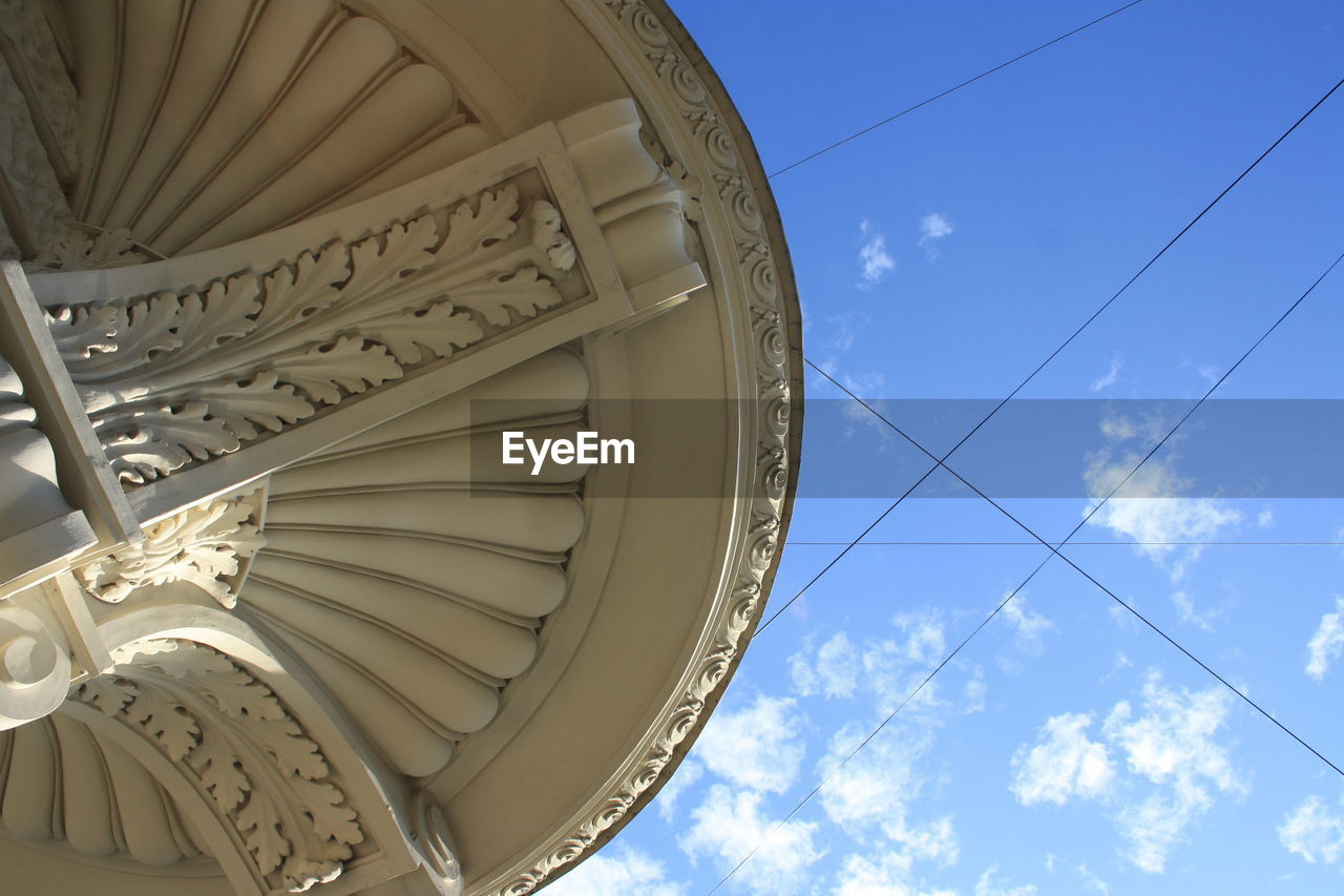 low angle view, sky, built structure, no people, architecture, day, pattern, blue, nature, cloud - sky, building exterior, sunlight, metal, outdoors, art and craft, design, white color, ornate, architectural feature, creativity, directly below, architecture and art