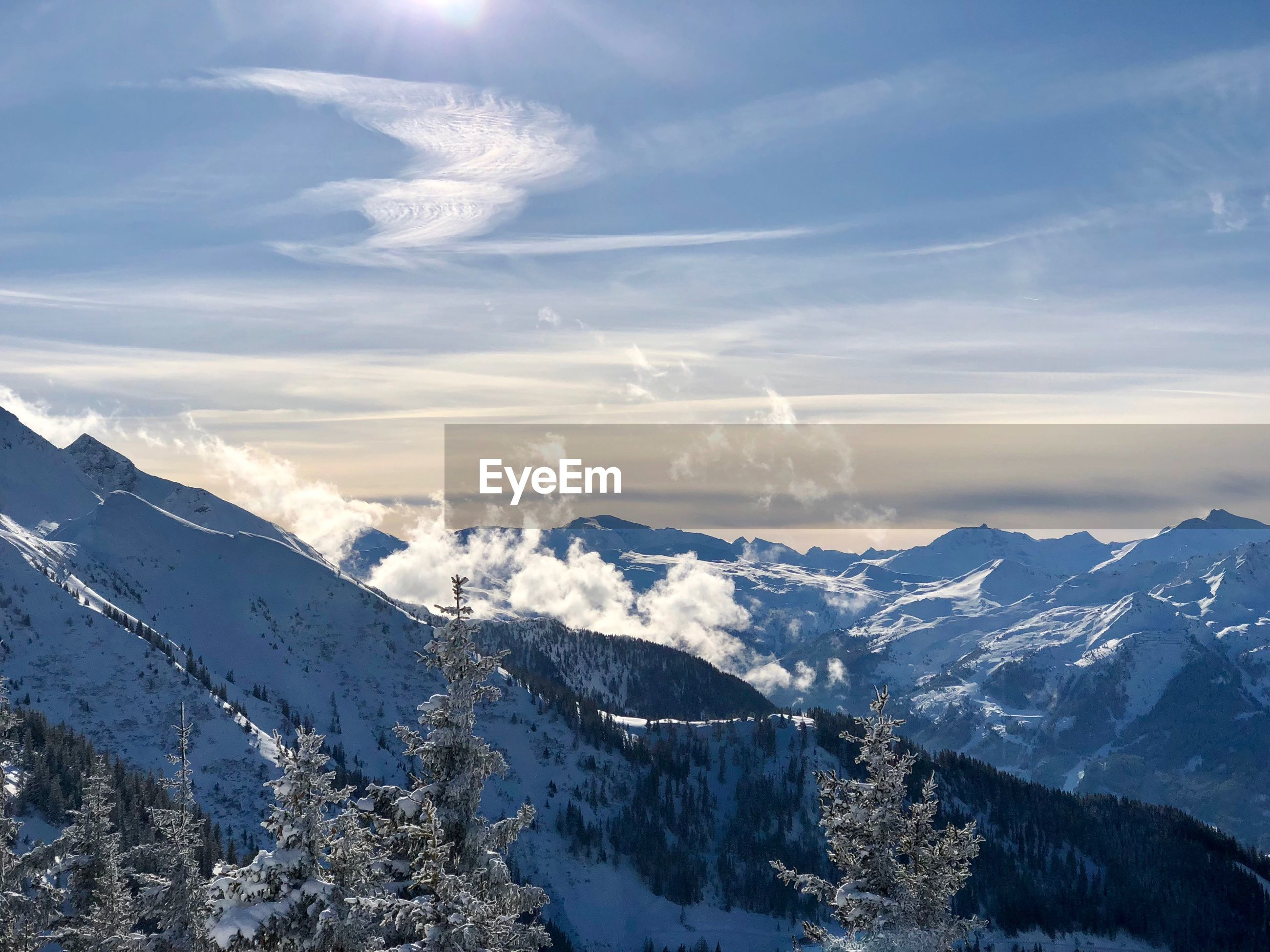 PANORAMIC SHOT OF SNOWCAPPED MOUNTAINS AGAINST SKY