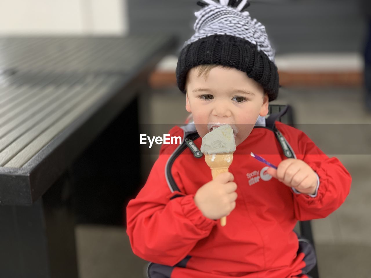 CUTE BOY HOLDING ICE CREAM OUTDOORS