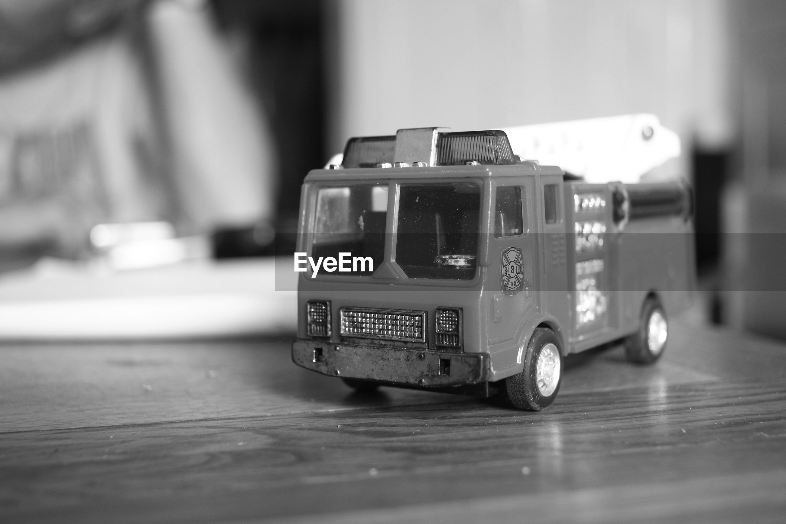 Close-up of toy fire engine on table