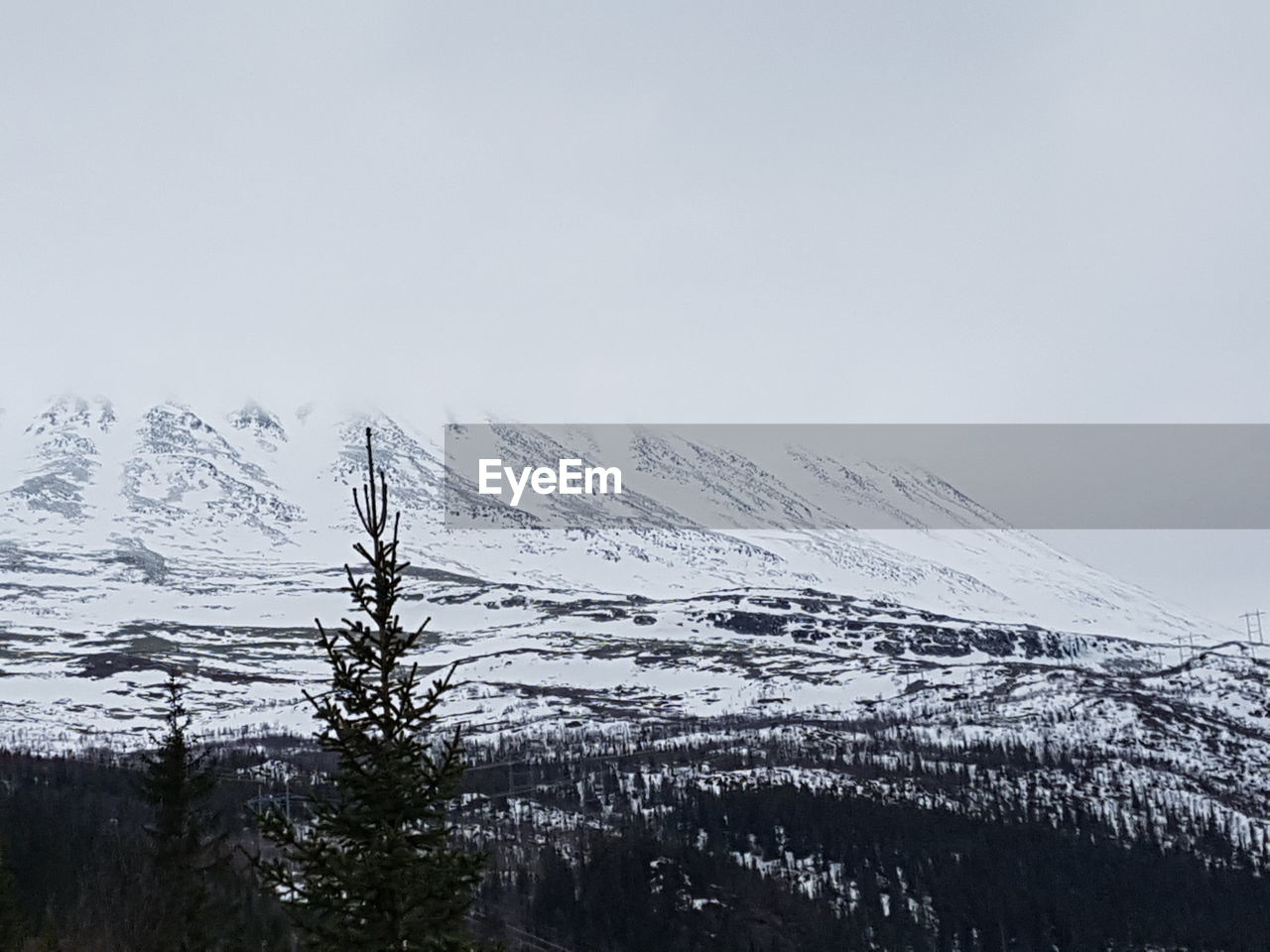 snow, winter, cold temperature, weather, nature, mountain, beauty in nature, scenics, tranquil scene, tranquility, snowcapped mountain, landscape, frozen, no people, clear sky, outdoors, mountain range, sky, day