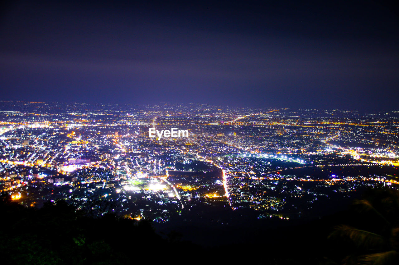 illuminated, city, night, building exterior, cityscape, architecture, built structure, sky, aerial view, high angle view, crowd, nature, crowded, building, outdoors, city life, glowing, residential district, copy space, light, nightlife, skyscraper