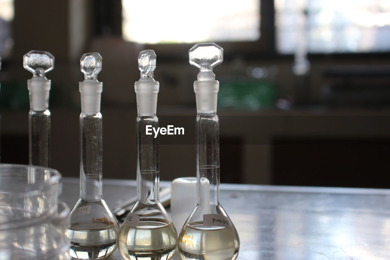 CLOSE-UP OF GLASSES ON TABLE