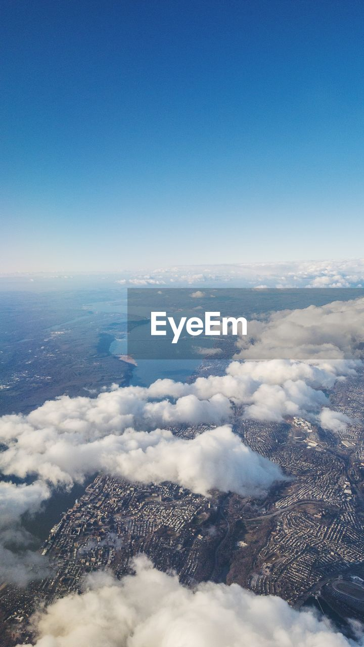 scenics - nature, beauty in nature, sky, aerial view, cloud - sky, no people, tranquility, copy space, tranquil scene, nature, day, outdoors, blue, white color, idyllic, environment, cloudscape, mountain, fluffy, above