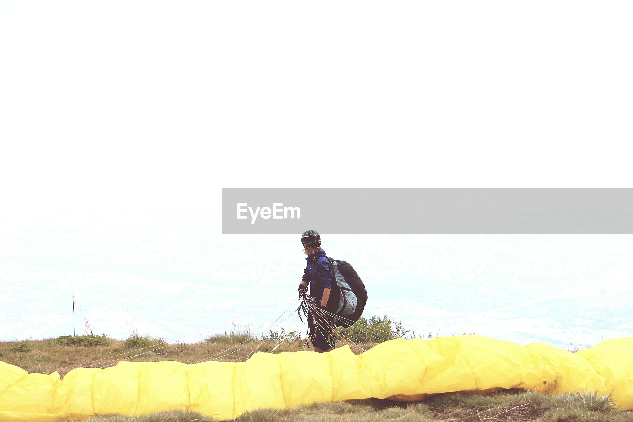 Paraglider preparing for gliding