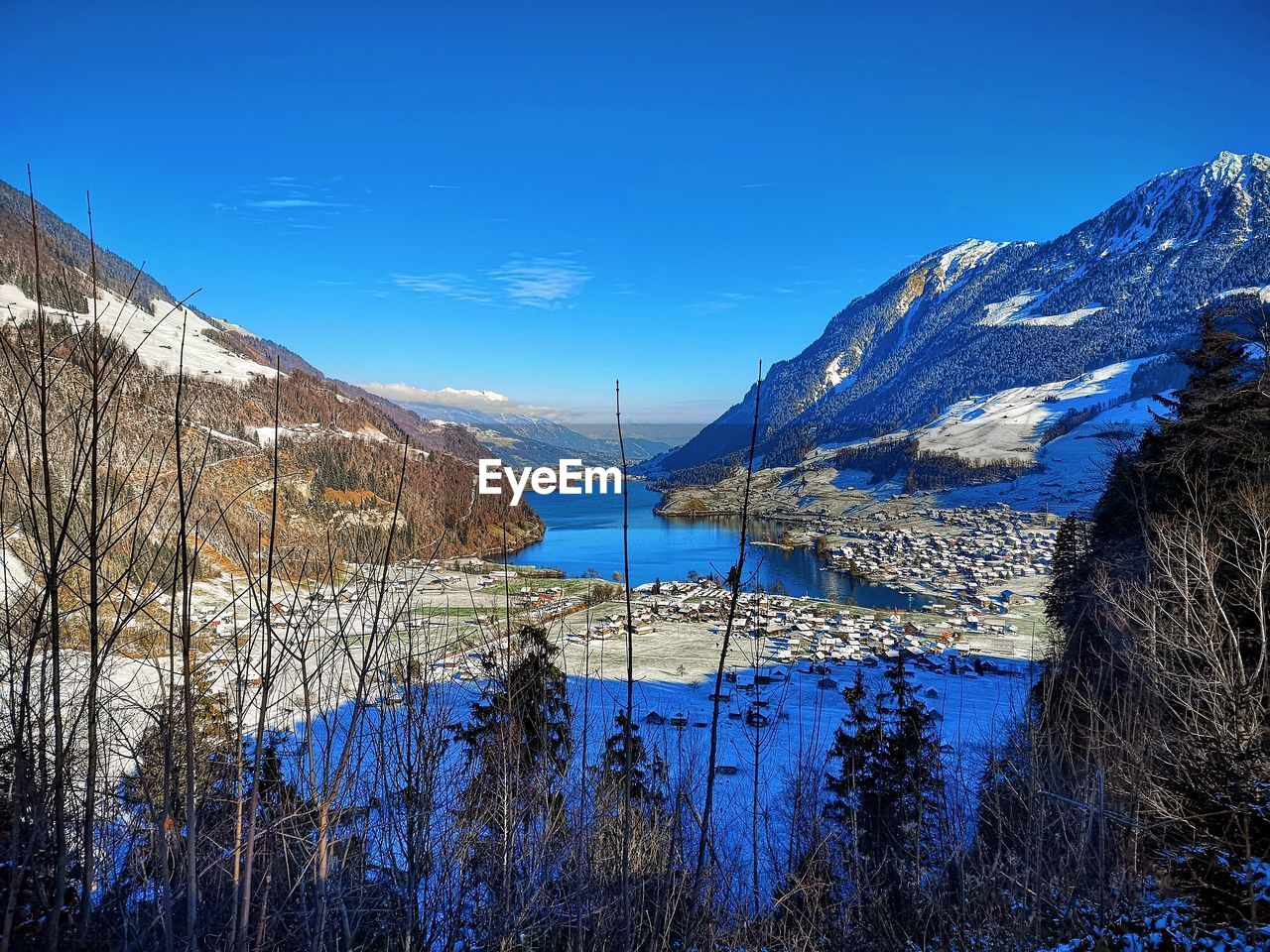 water, sky, mountain, blue, winter, beauty in nature, tranquil scene, scenics - nature, plant, cold temperature, snow, tranquility, nature, no people, lake, tree, mountain range, non-urban scene, reflection, outdoors, snowcapped mountain
