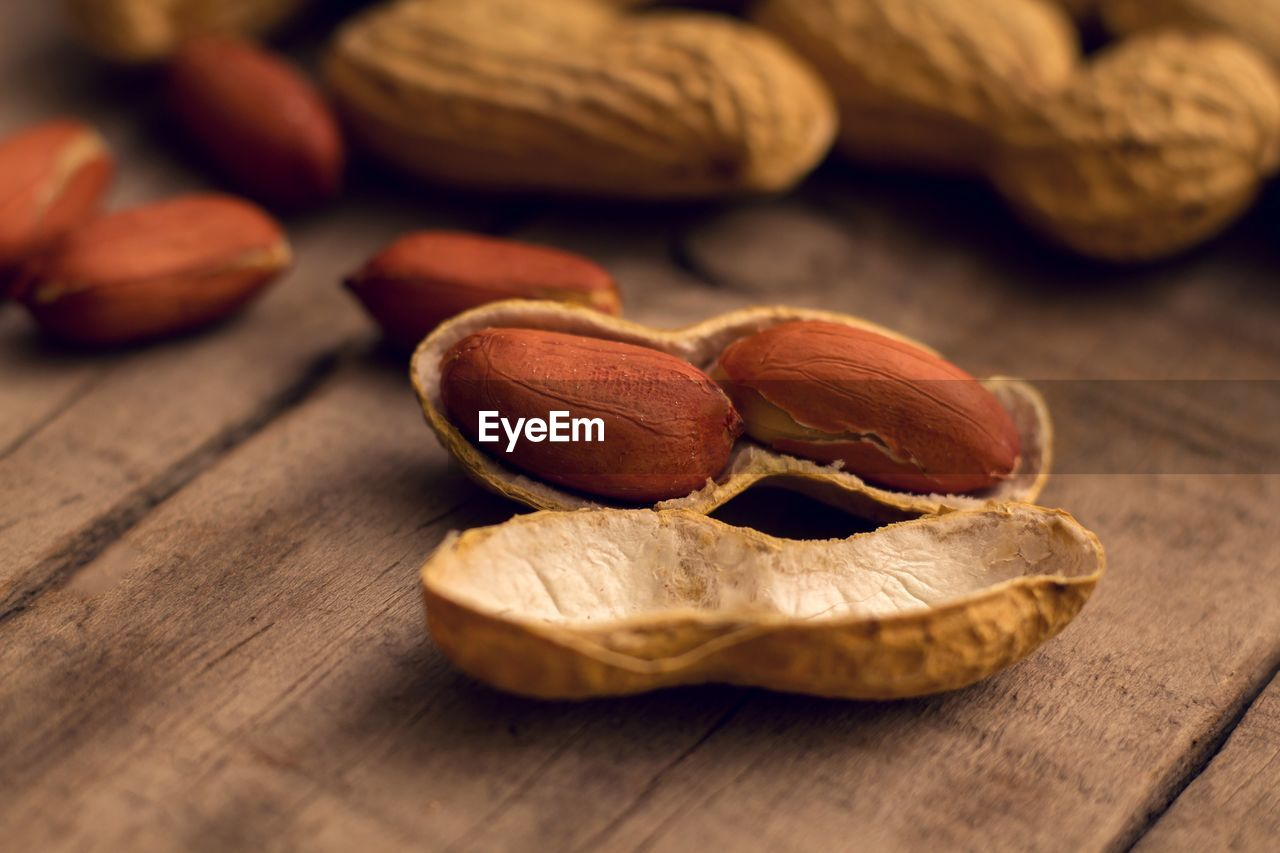 food, food and drink, still life, table, close-up, wellbeing, nut, healthy eating, nut - food, brown, freshness, indoors, no people, wood - material, selective focus, focus on foreground, nutshell, raw food, fruit, group of objects