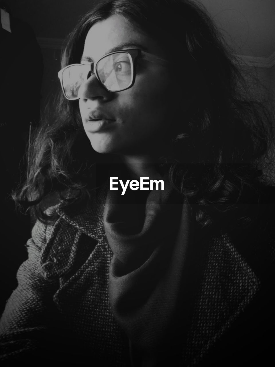 glasses, eyeglasses, headshot, one person, portrait, lifestyles, front view, young adult, indoors, real people, young women, casual clothing, leisure activity, hairstyle, women, looking, close-up, looking away, contemplation, beautiful woman, teenager