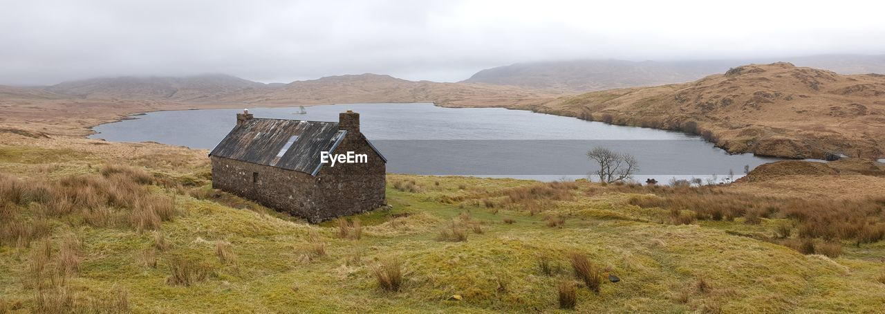 Scenic view of landscape against sky bothy by the loch