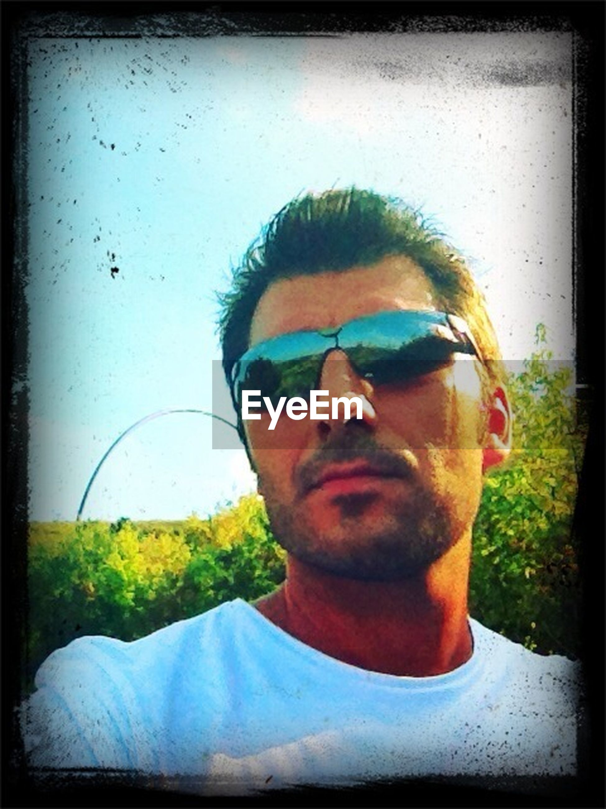 portrait, looking at camera, person, lifestyles, headshot, young adult, sunglasses, young men, leisure activity, front view, mid adult men, mid adult, head and shoulders, auto post production filter, smiling, casual clothing, close-up, transfer print