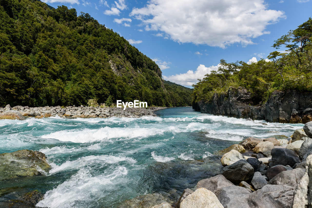 water, beauty in nature, rock, sky, cloud - sky, tree, solid, scenics - nature, rock - object, motion, nature, plant, flowing water, sea, day, no people, land, mountain, outdoors, flowing
