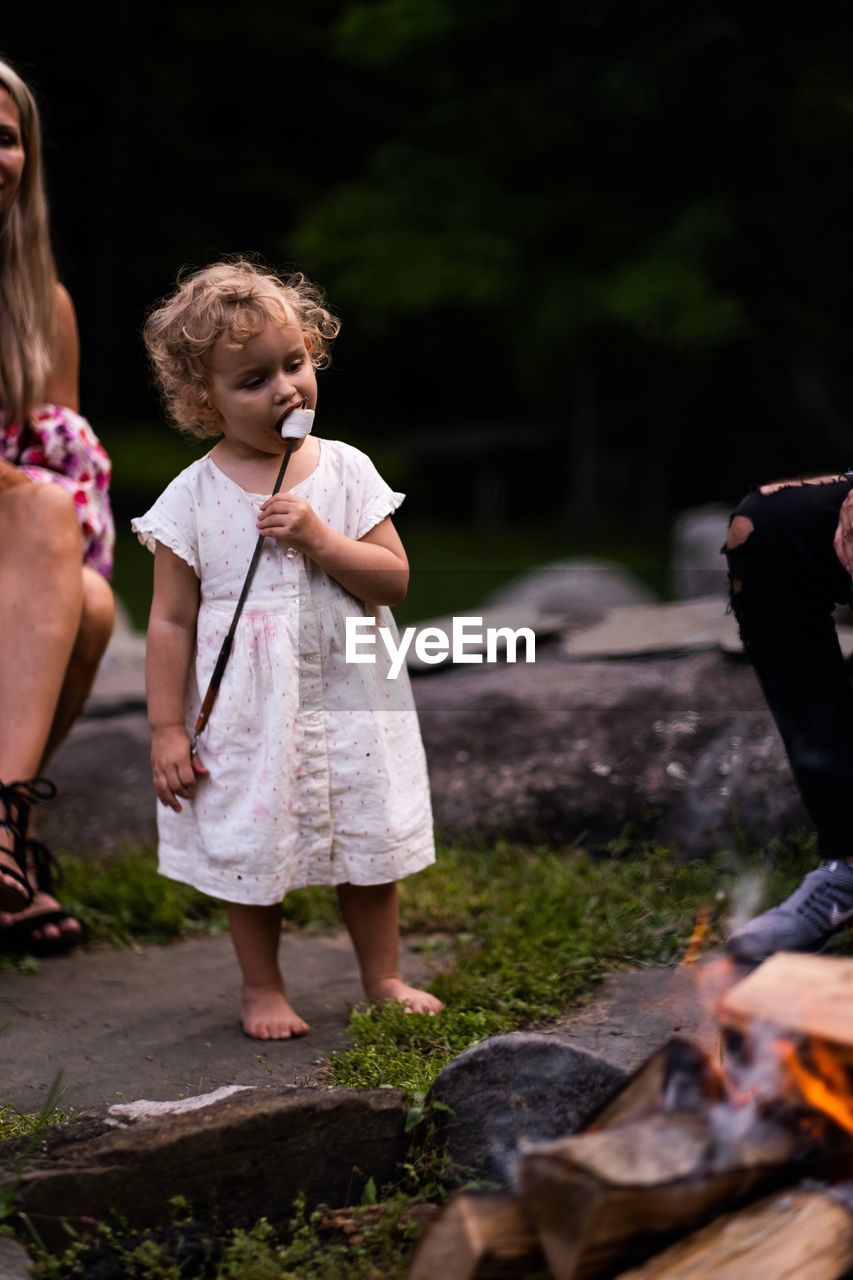 child, childhood, girls, females, women, leisure activity, family, full length, real people, togetherness, people, nature, casual clothing, offspring, day, standing, innocence, bonding, outdoors, daughter, sister, campfire