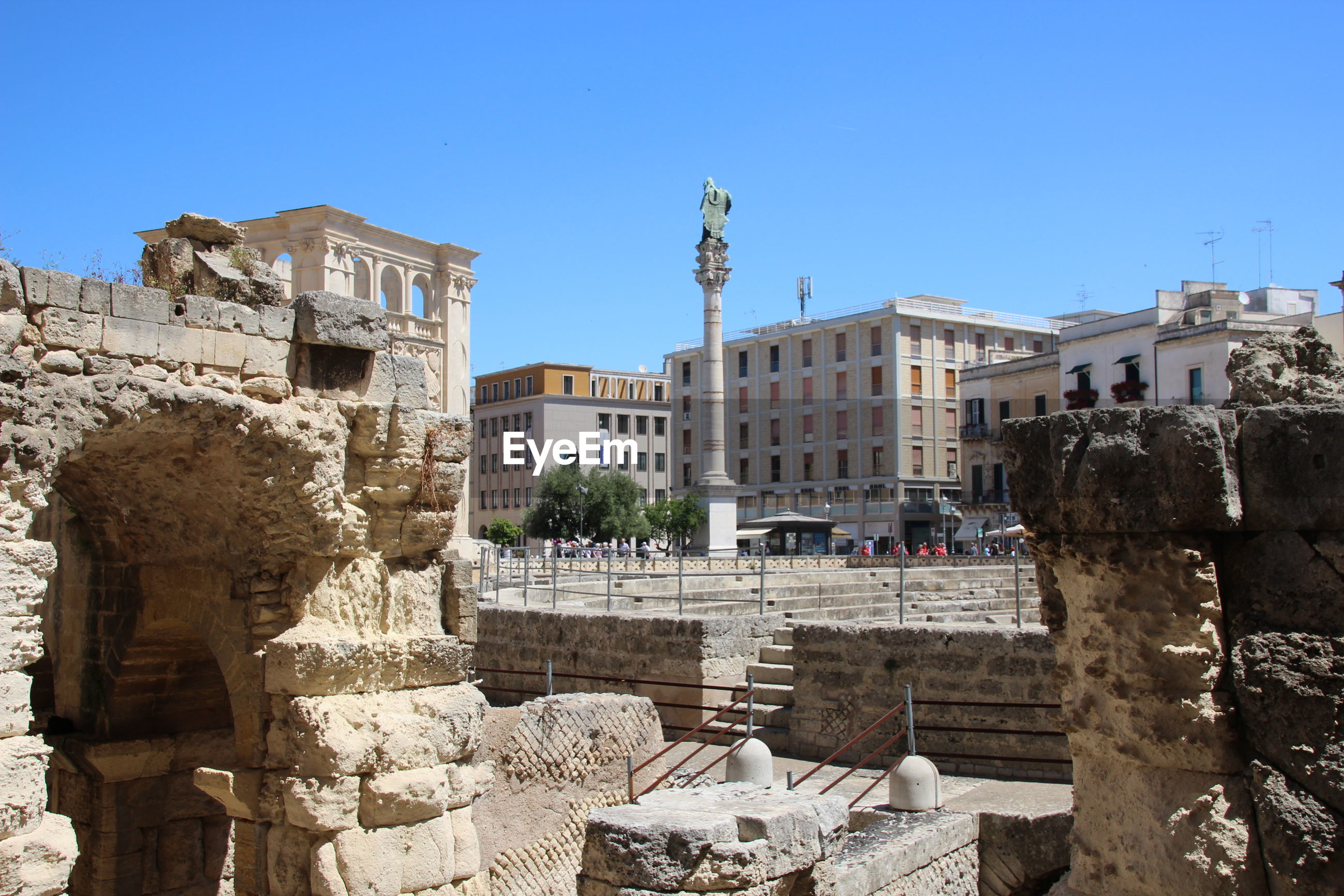 Roman forum against clear blue sky in city on sunny day