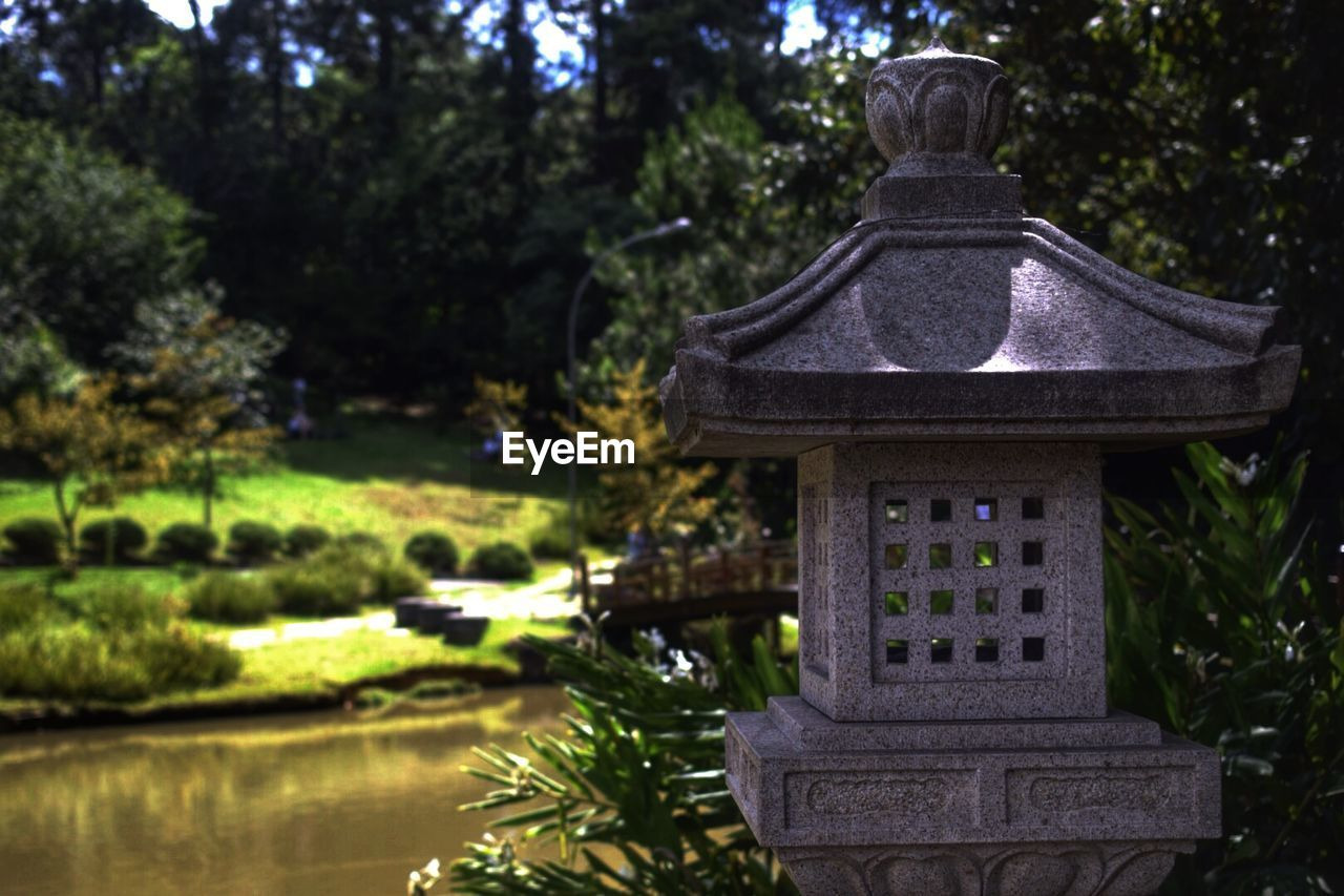Close-up of stone lantern in park