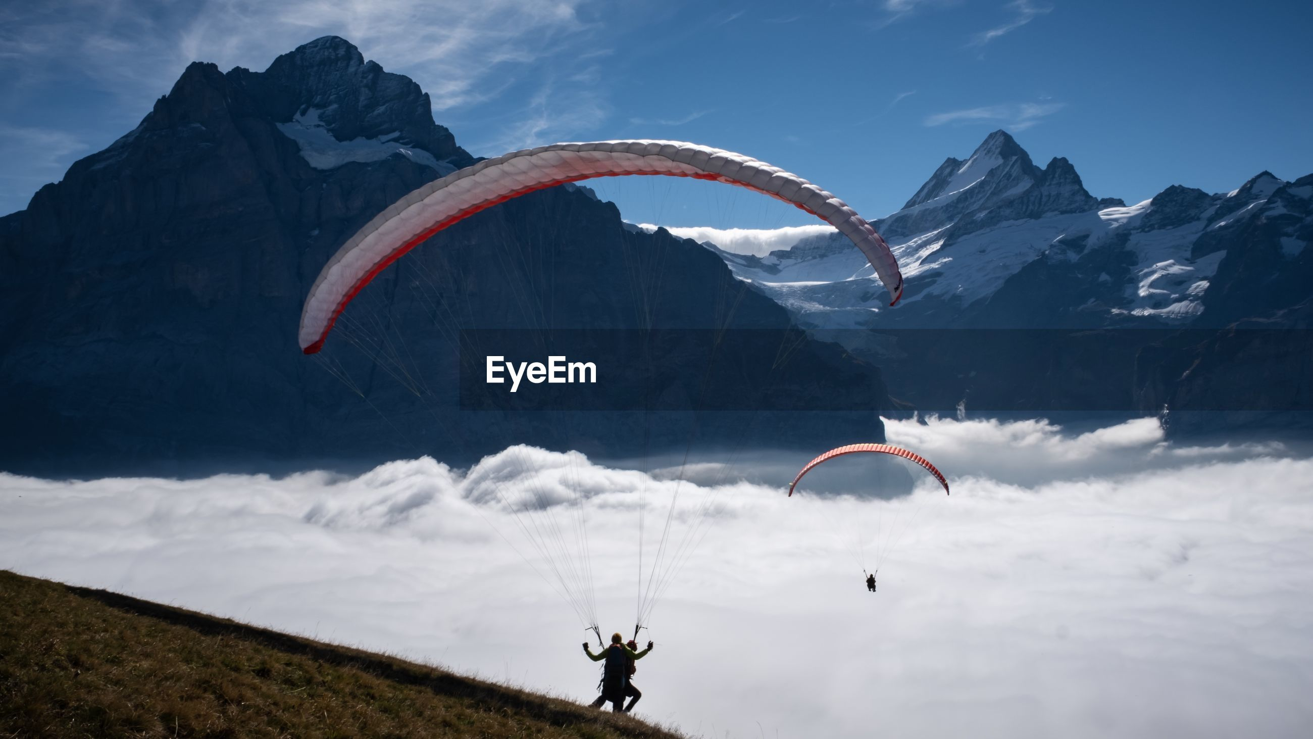 High angle view of people paragliding