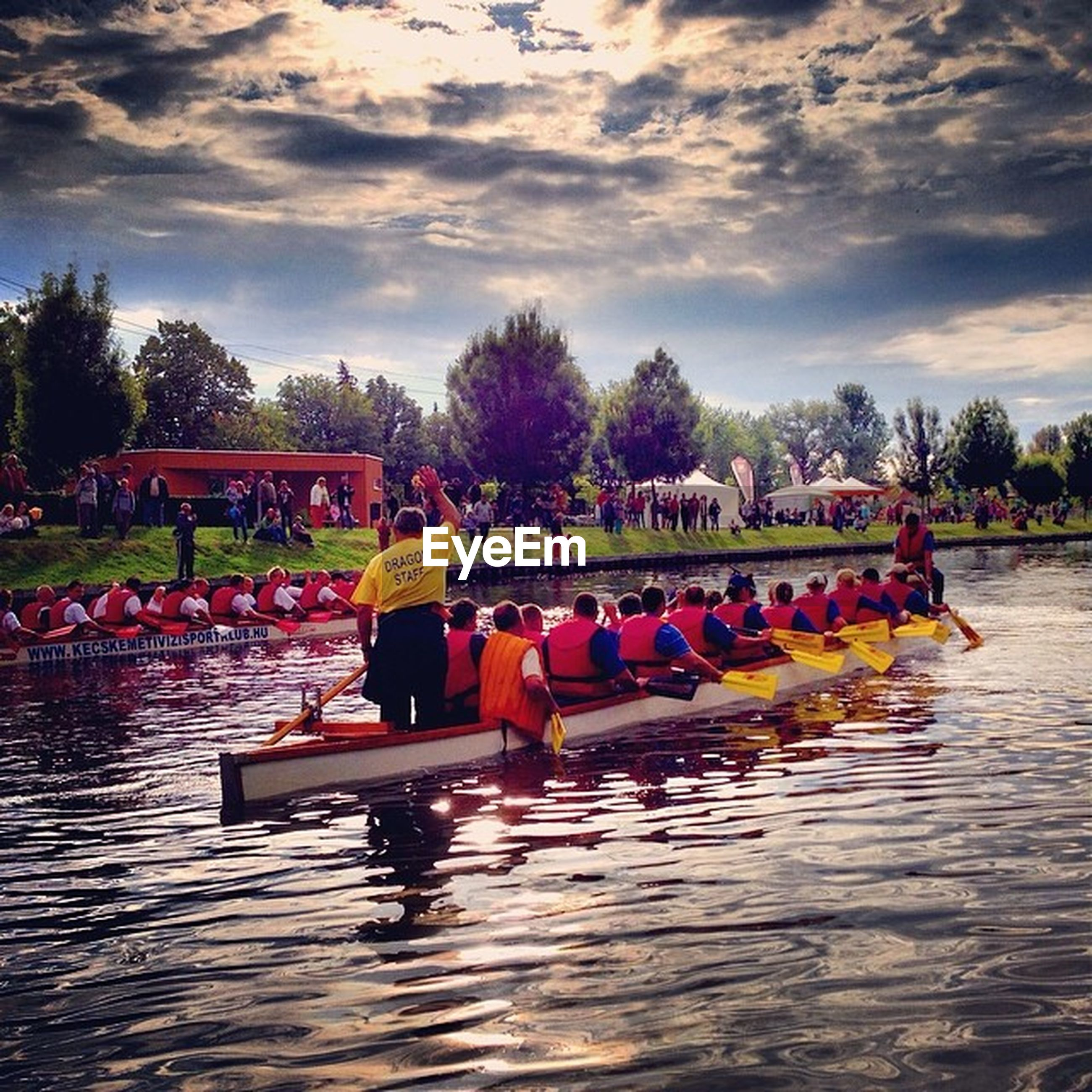sky, tree, cloud - sky, water, lifestyles, leisure activity, person, large group of people, men, cloud, built structure, lake, cloudy, outdoors, nature, relaxation, park - man made space, togetherness, sitting