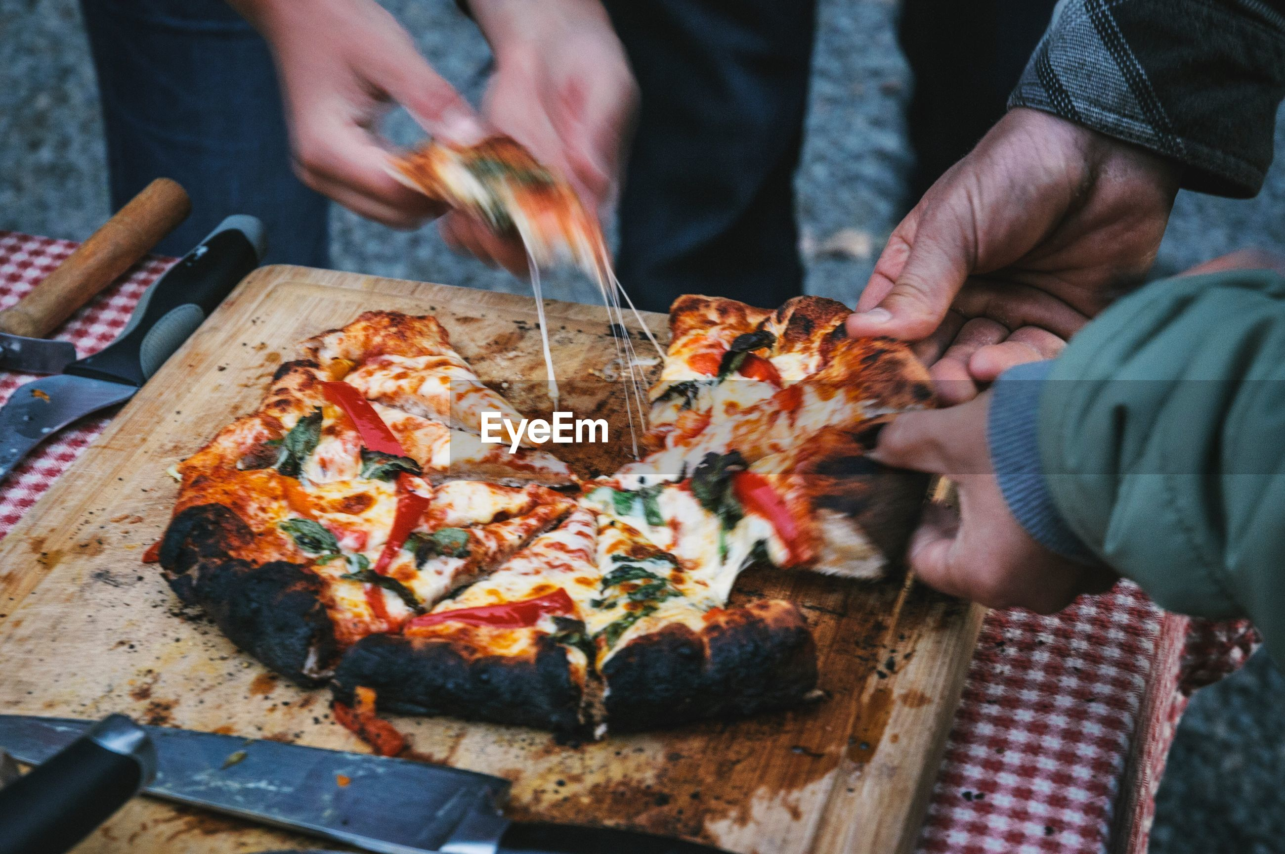 Friends having pizza on table