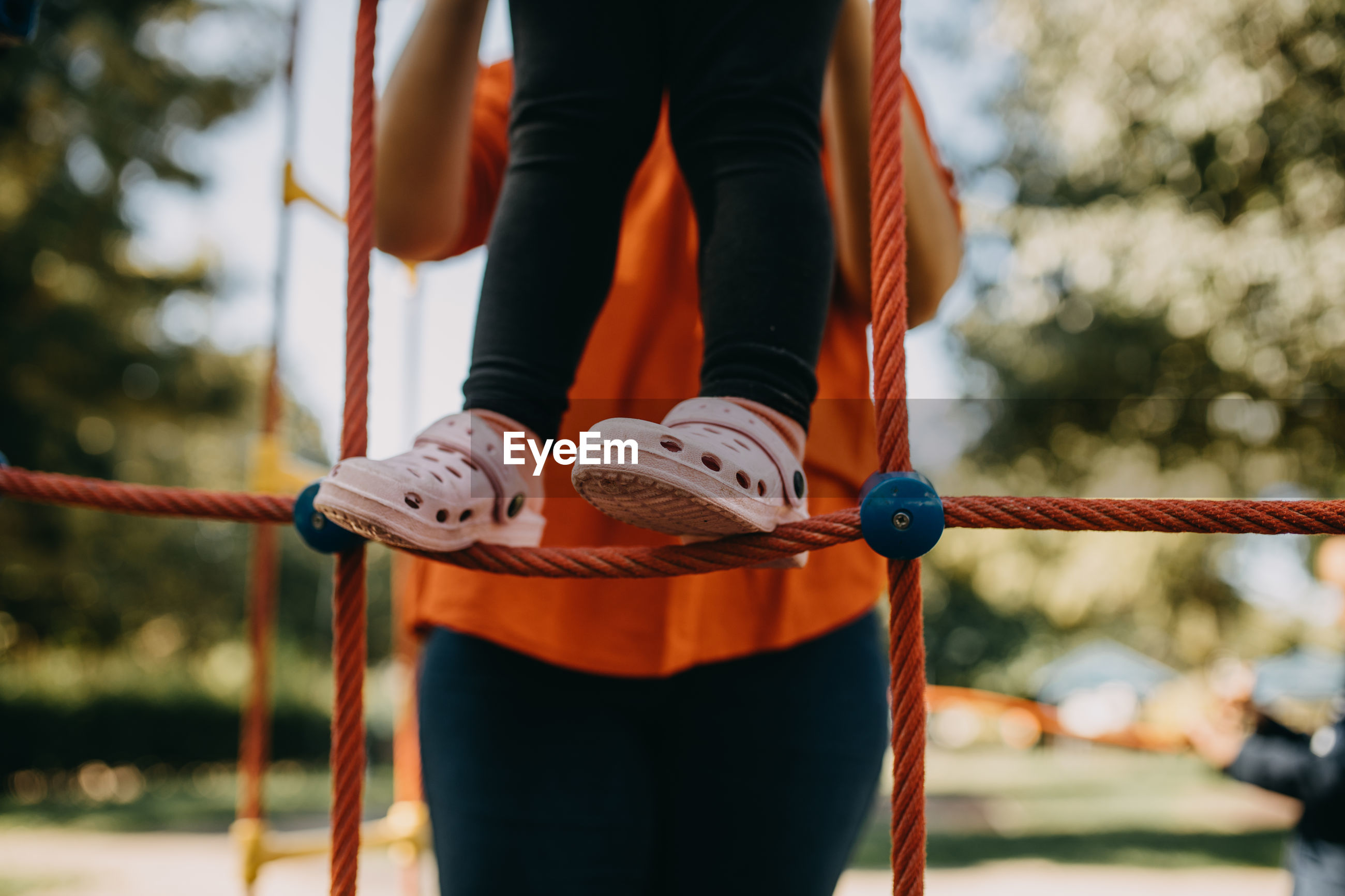 Low section of person standing on rope