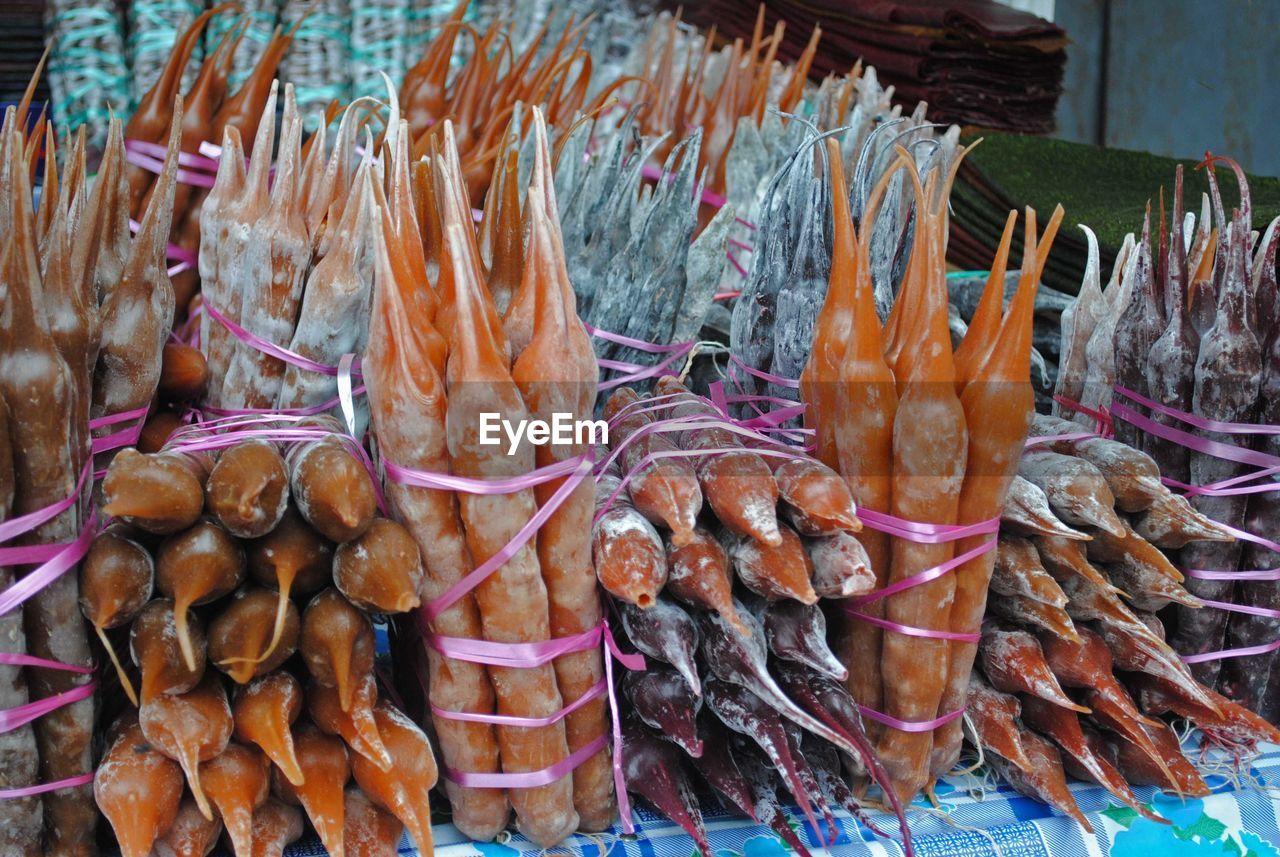 Bundles of churchkhelas for sale at market stall
