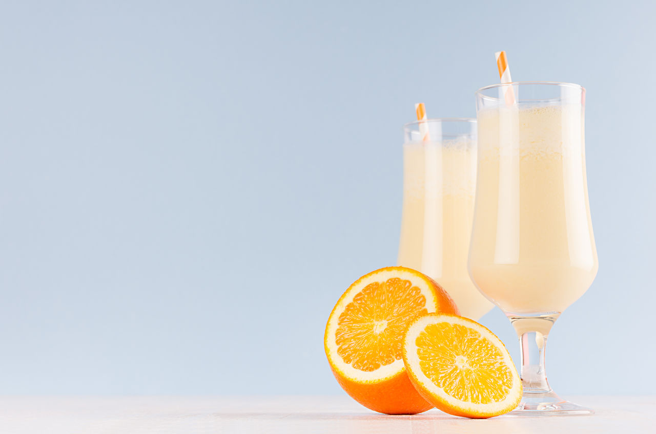 food and drink, drink, refreshment, food, glass, fruit, citrus fruit, healthy eating, freshness, drinking glass, wellbeing, orange - fruit, indoors, table, orange, orange color, no people, copy space, straw, household equipment, fruit juice