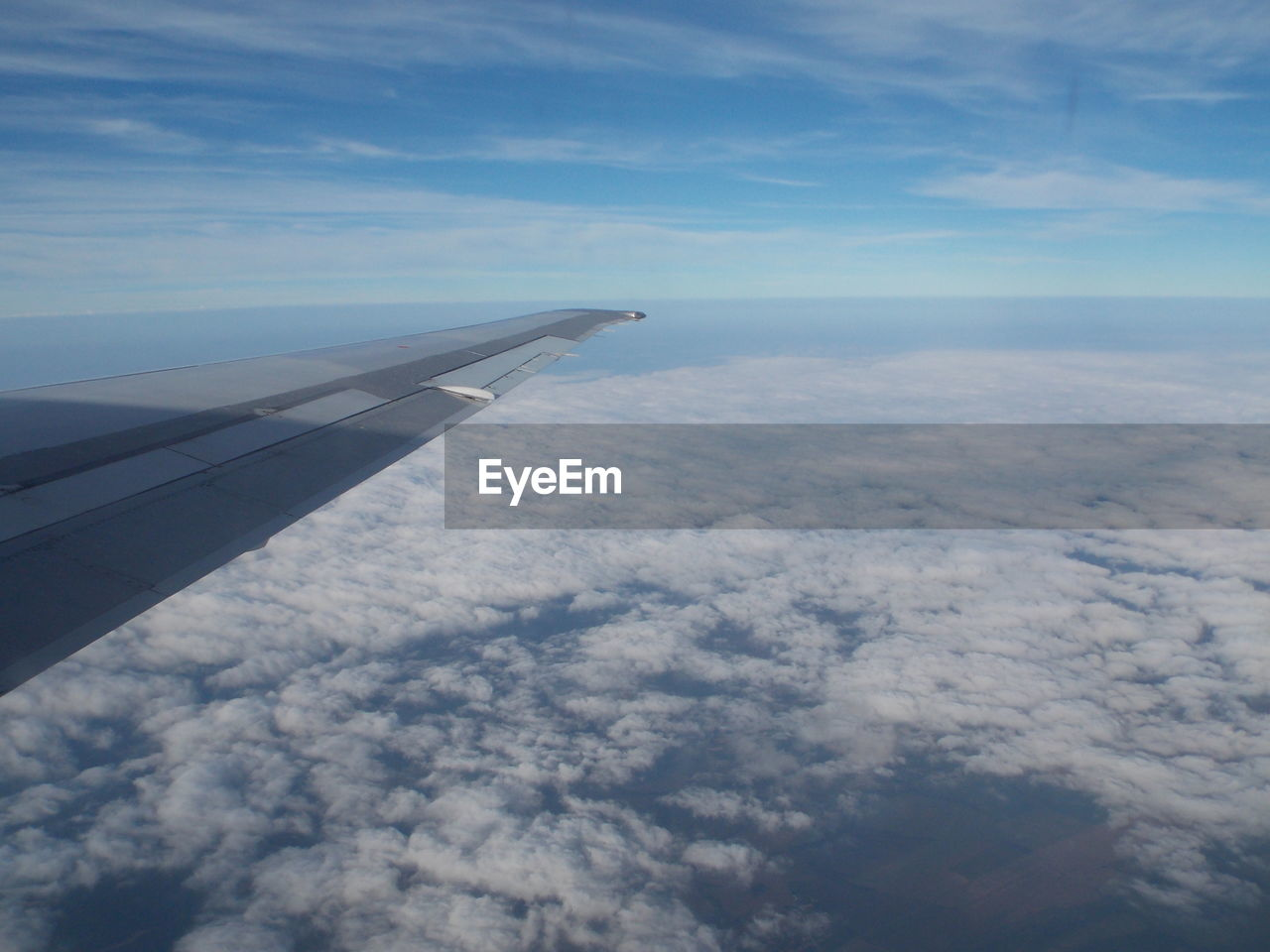 aerial view, cloud - sky, airplane, sky, transportation, nature, beauty in nature, scenics, journey, travel, airplane wing, no people, blue, tranquility, day, outdoors, tranquil scene, mid-air, flying, air vehicle, landscape, the natural world