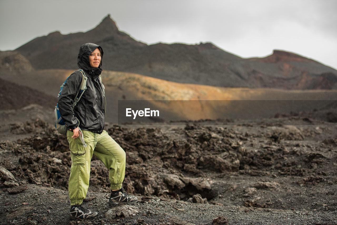 Portrait Of Woman Standing Against Sierra Negra Volcano