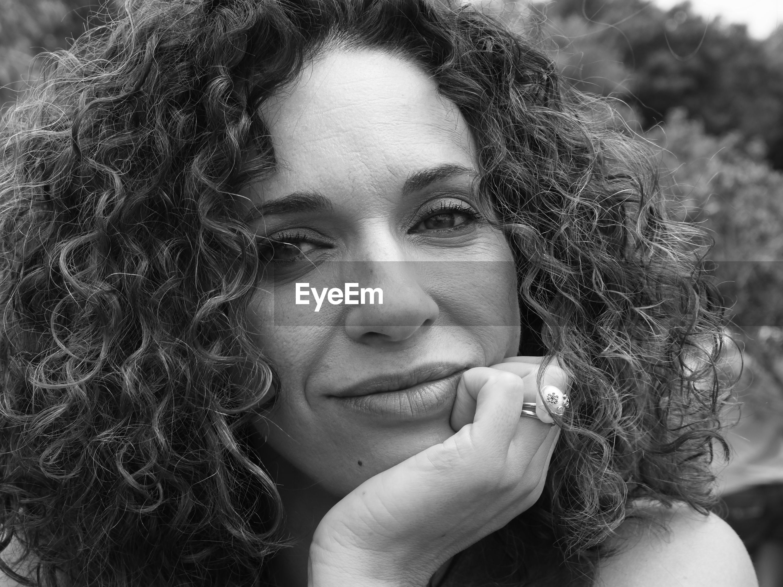 Close-up portrait of woman with curly hair