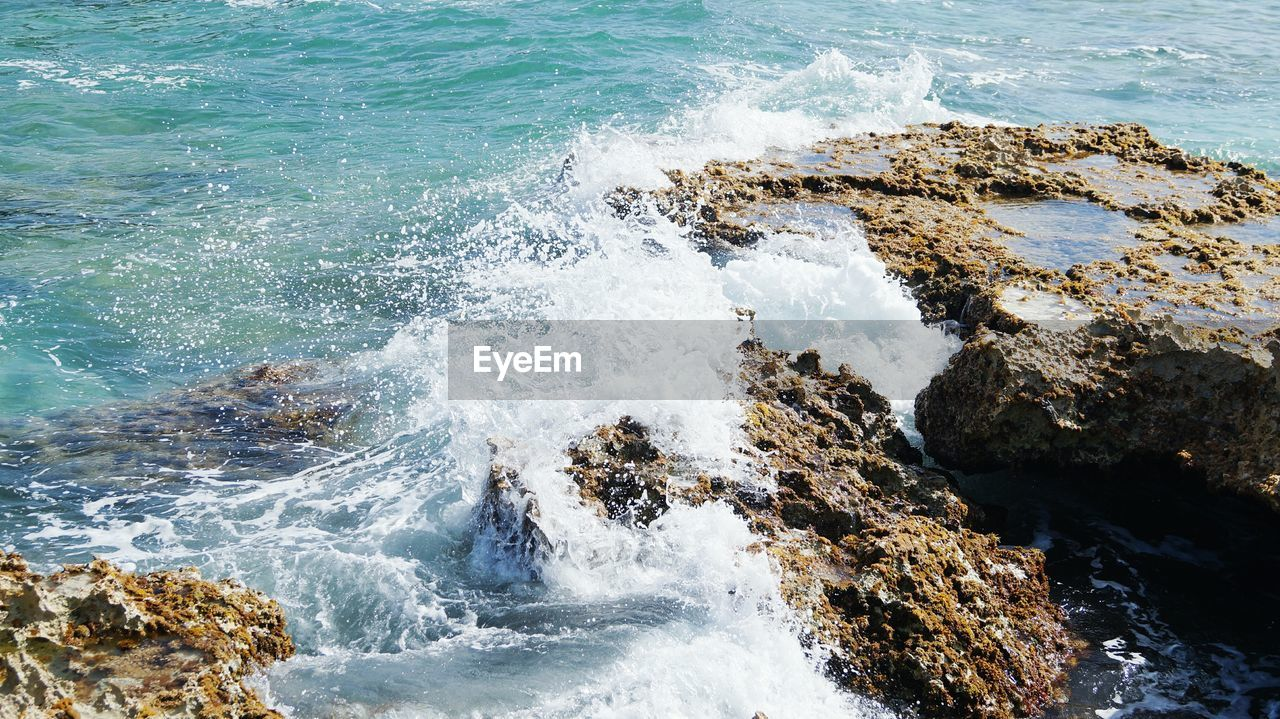 sea, water, nature, motion, rock - object, wave, beauty in nature, no people, day, outdoors, scenics