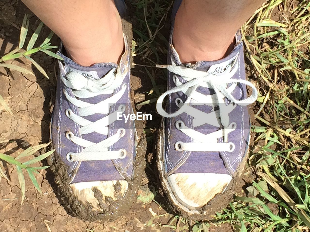 low section, shoe, human leg, high angle view, real people, human body part, one person, day, outdoors, field, lifestyles, standing, directly above, men, grass, close-up, adult, people