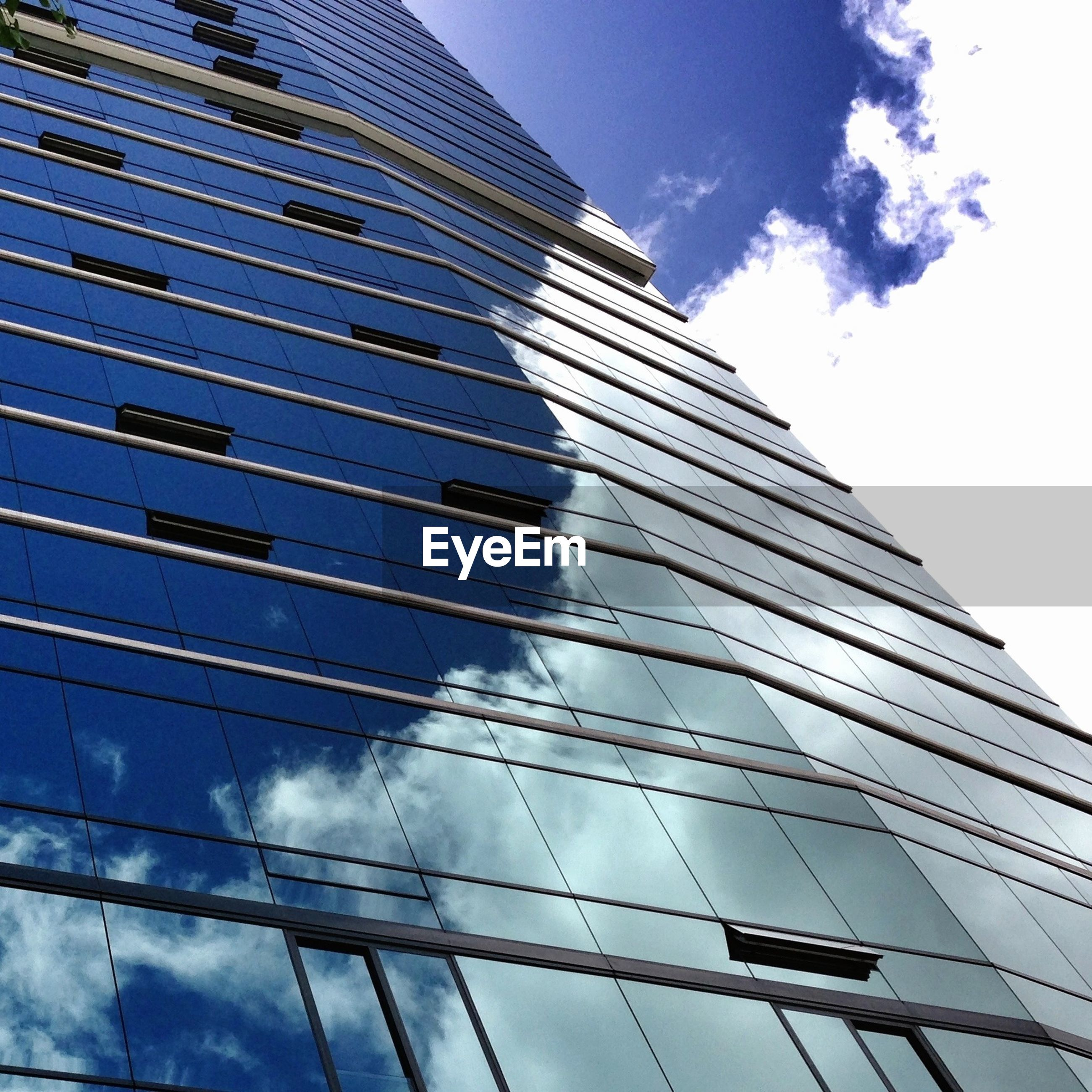 Clouds reflecting in glass facade