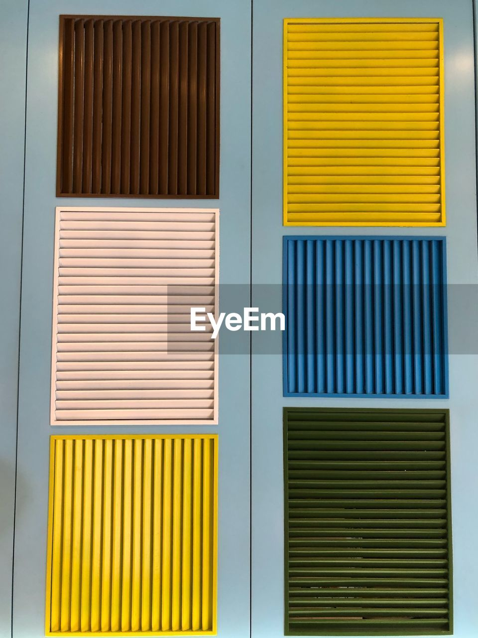 yellow, architecture, no people, built structure, pattern, building exterior, wall - building feature, window, closed, building, day, full frame, shutter, backgrounds, metal, corrugated iron, outdoors, striped, blinds, close-up, iron, corrugated