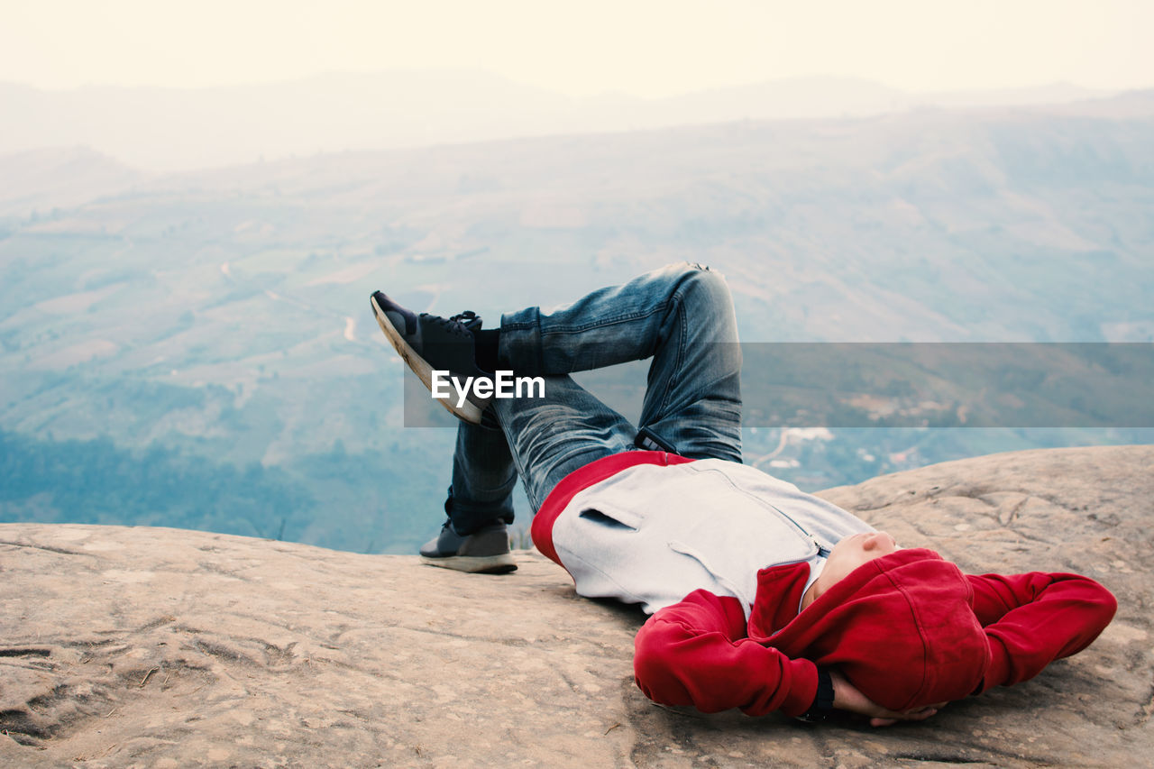 Man Lying On Mountains