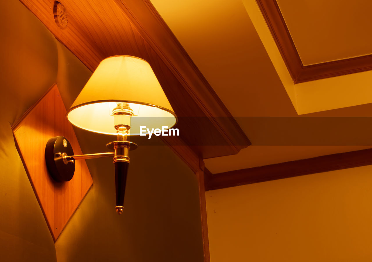 lighting equipment, illuminated, electricity, indoors, electric lamp, ceiling, light, no people, low angle view, wall - building feature, glowing, electric light, architecture, technology, hanging, yellow, home interior, lamp shade, built structure, pendant light, light fixture, luxury