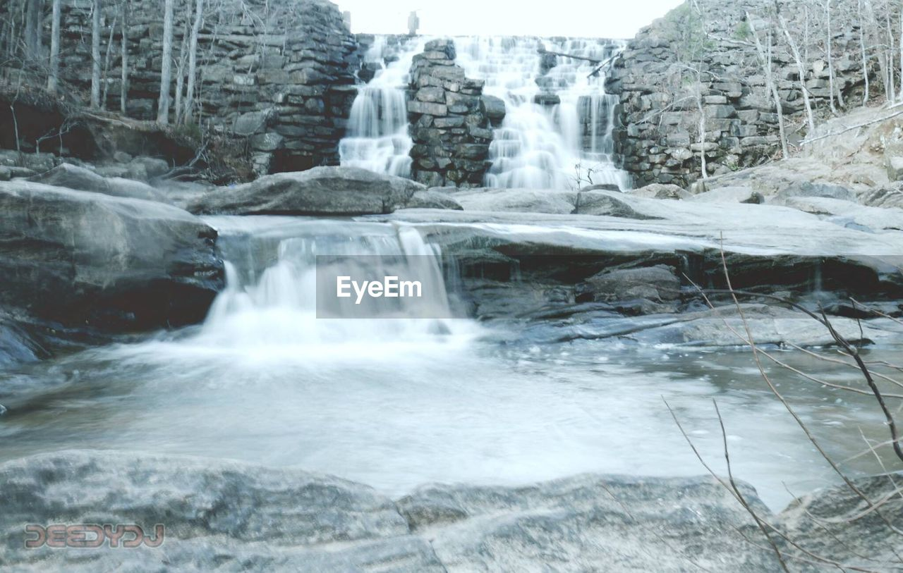 motion, waterfall, long exposure, water, nature, no people, beauty in nature, rock - object, winter, scenics, day, outdoors, cold temperature, sky