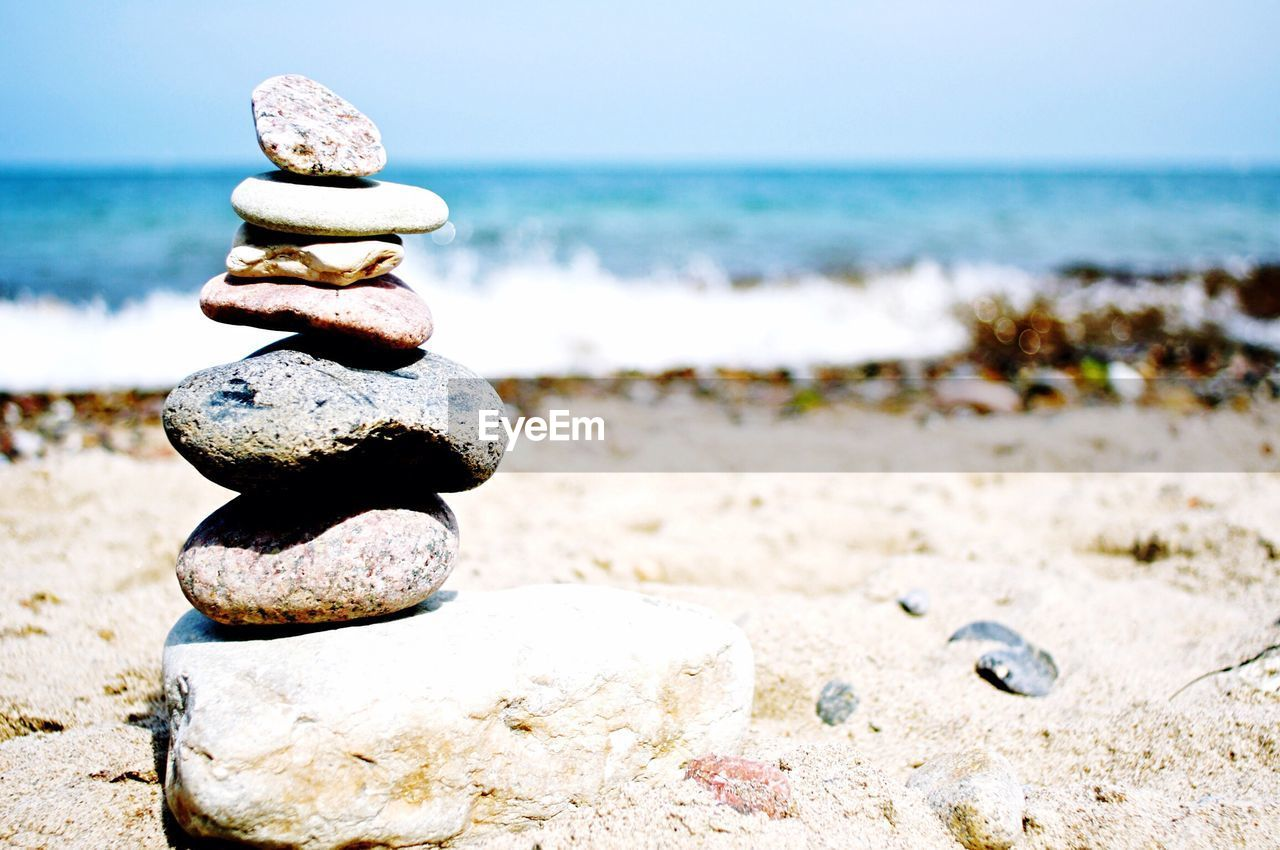Scenic view of rocks stacked on beach