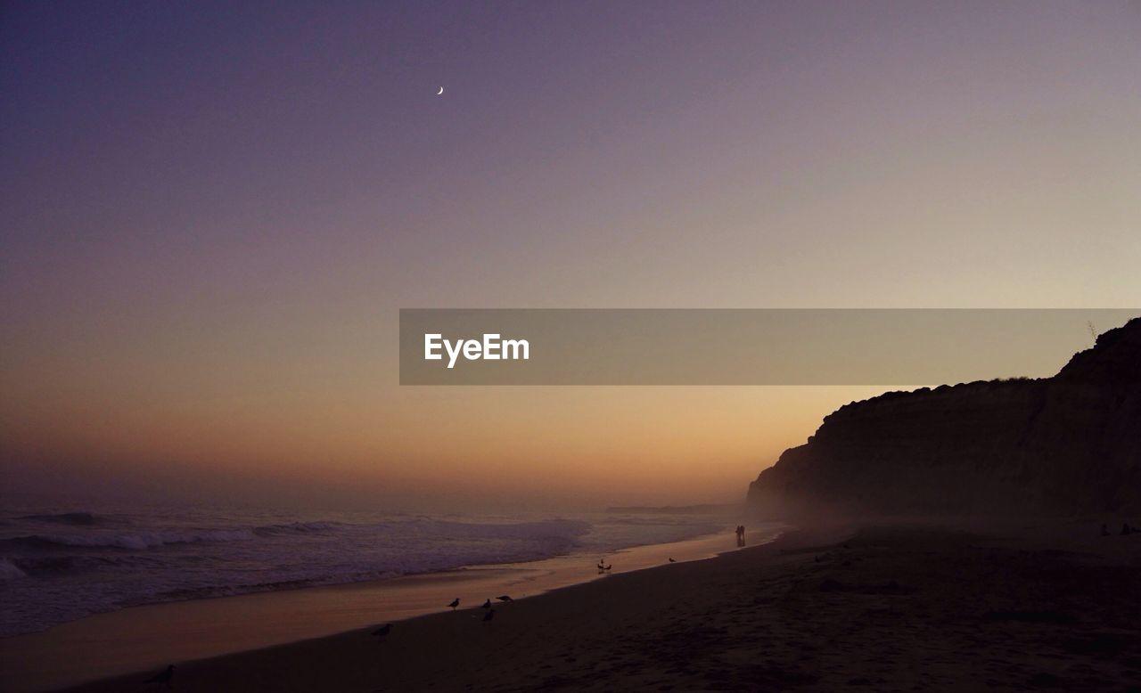 Scenic View Of Porto De Mos Praia During Sunset