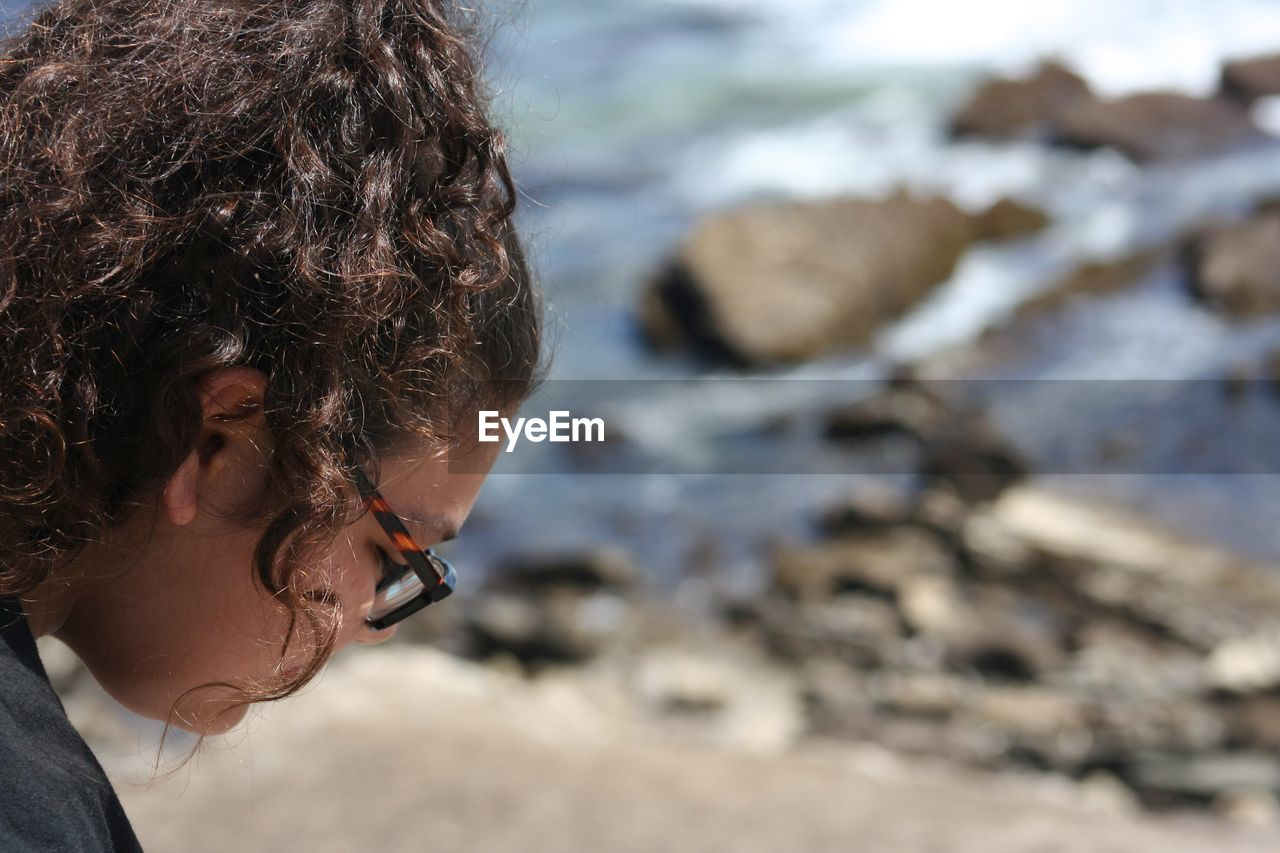 Young woman wearing eyeglasses at beach